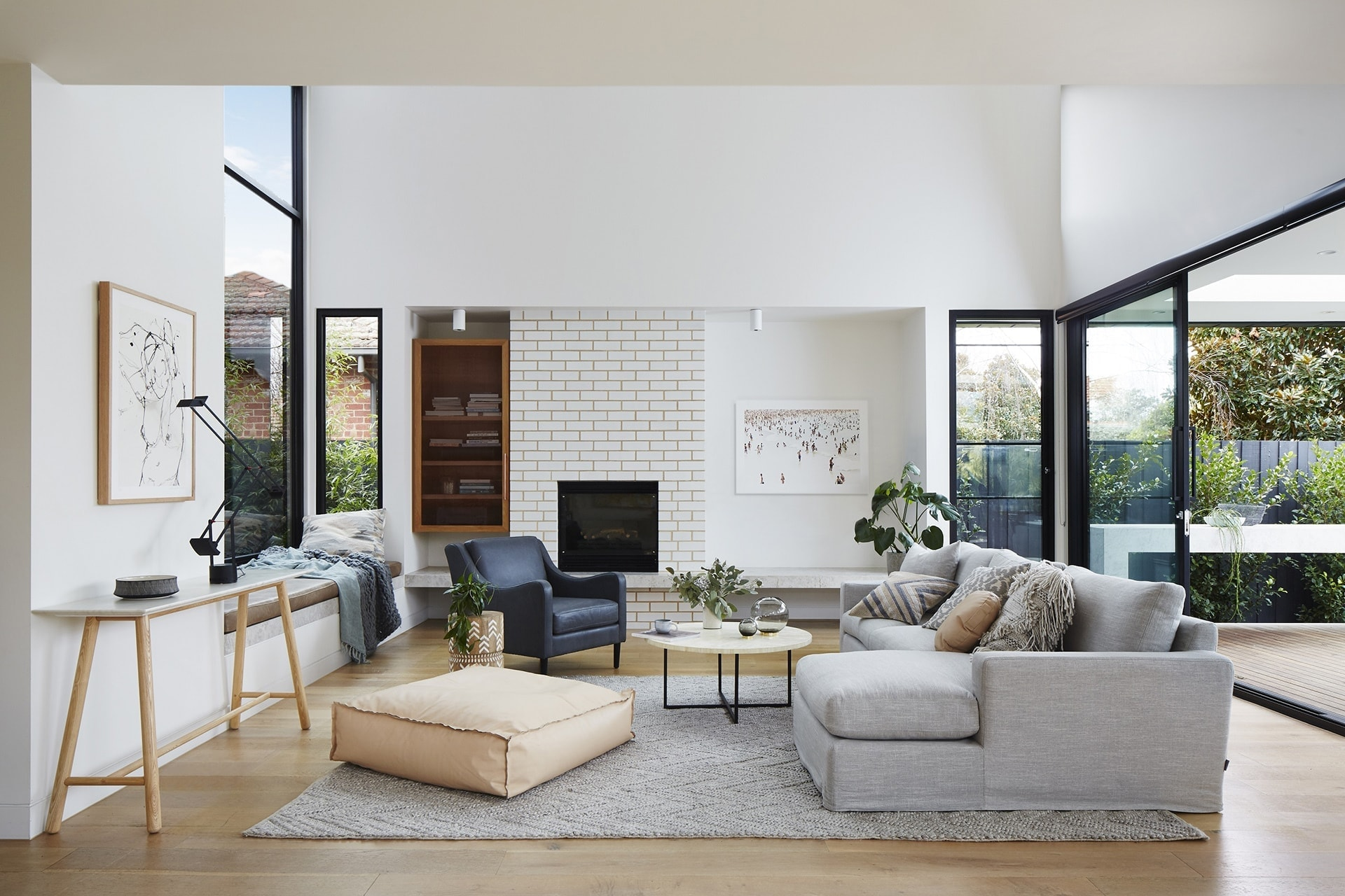 globewest grey living room with white exposed brick wall