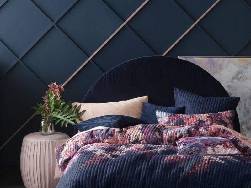 linen house dark floral bedding in dark blue room