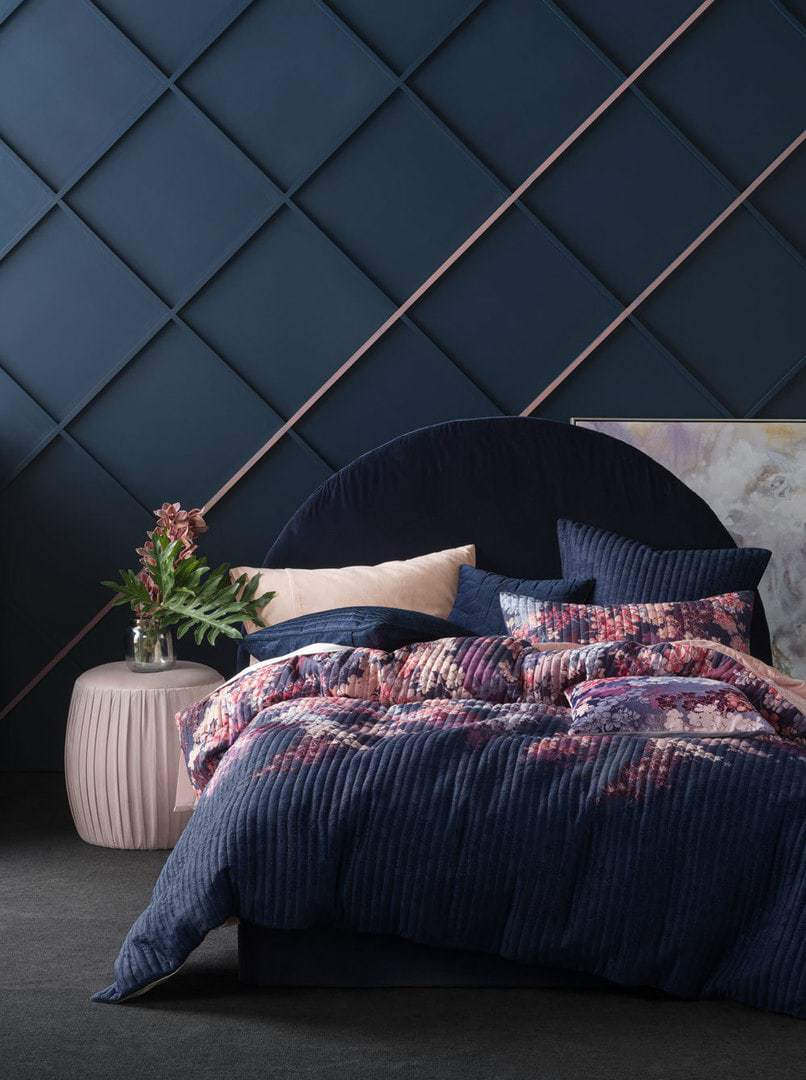 linen house dark floral bedding in dark blue room