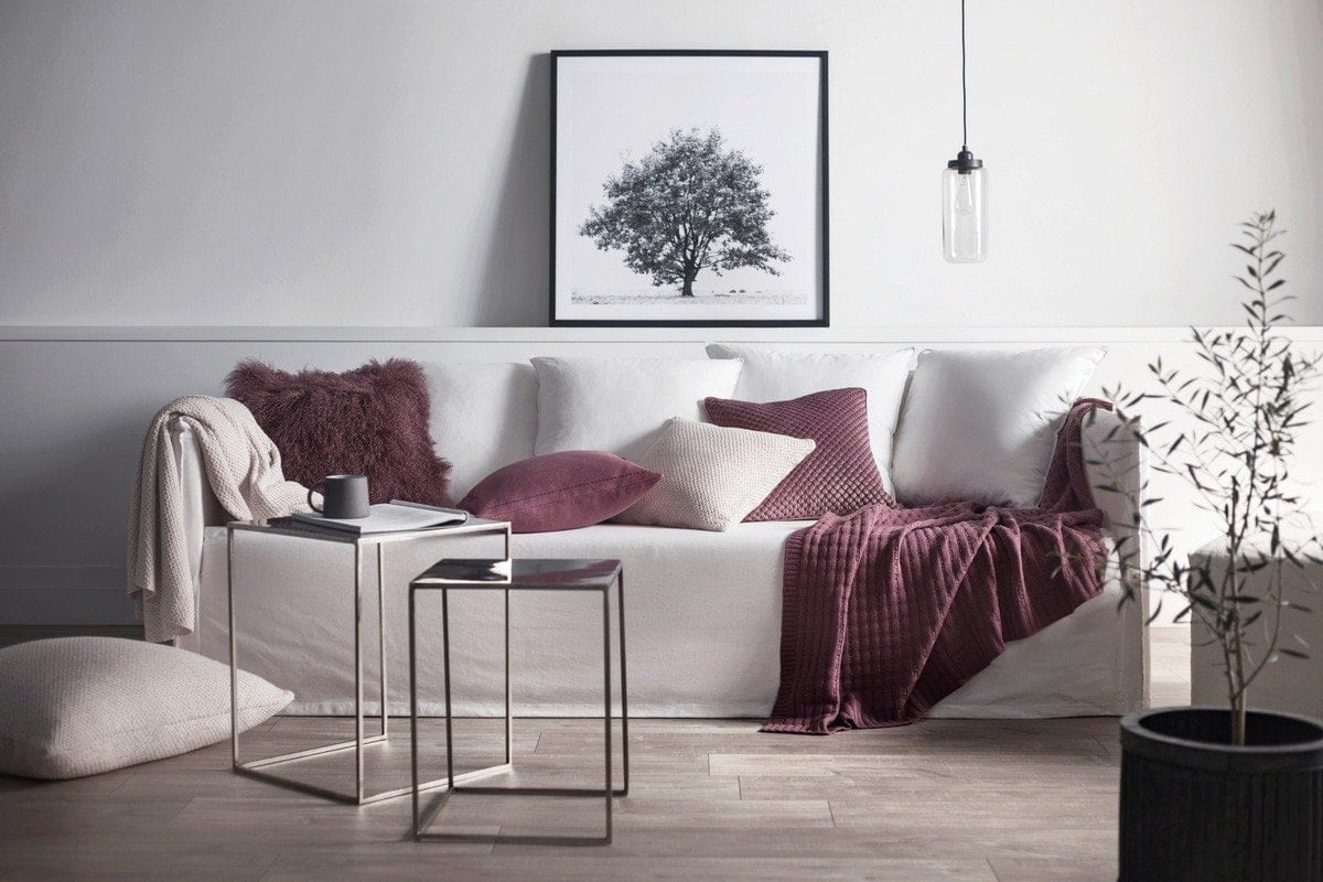 muddy pink cushions on light grey slipcover sofa