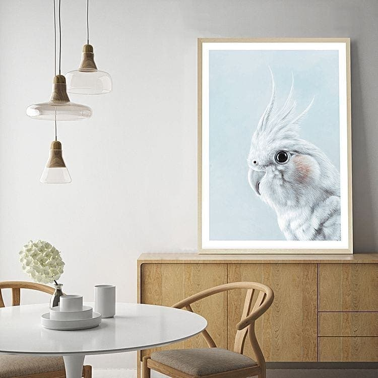 tan and baby blue dining room with bird art