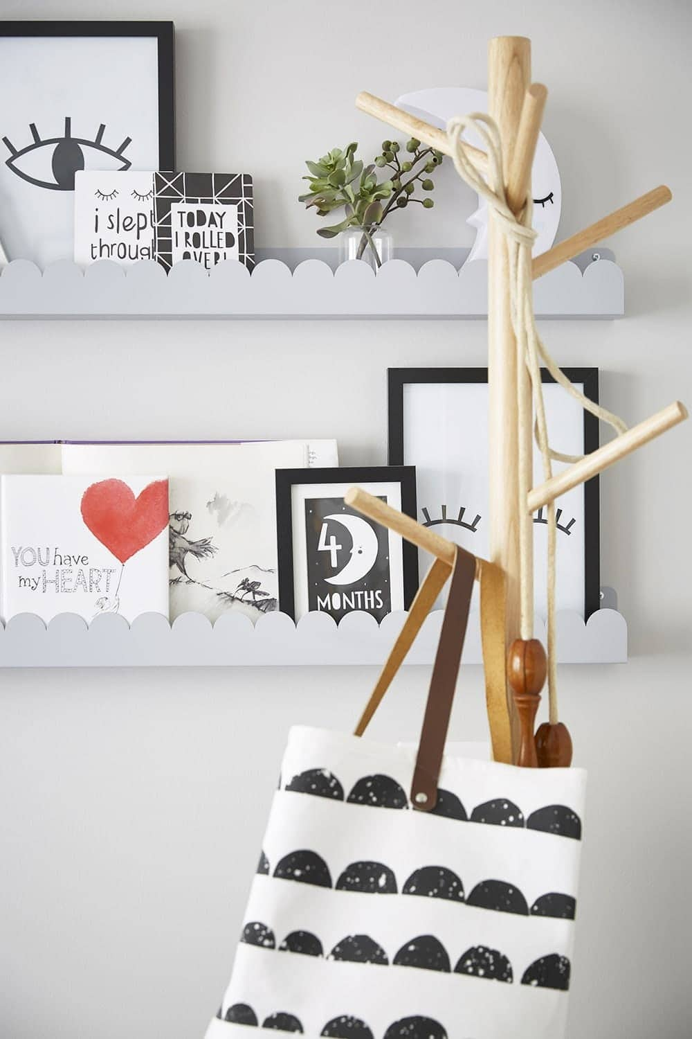 black and white kids bedroom with grey picture rail and books