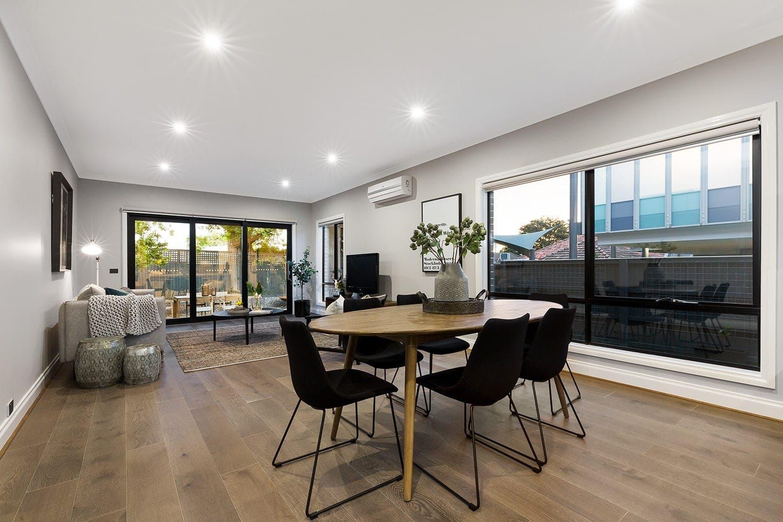 duplex home living room with dark floorboards