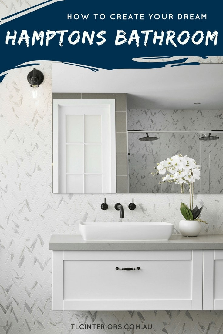 hamptons style bathroom with marble herringbone tiles and floating vanity and black tapware