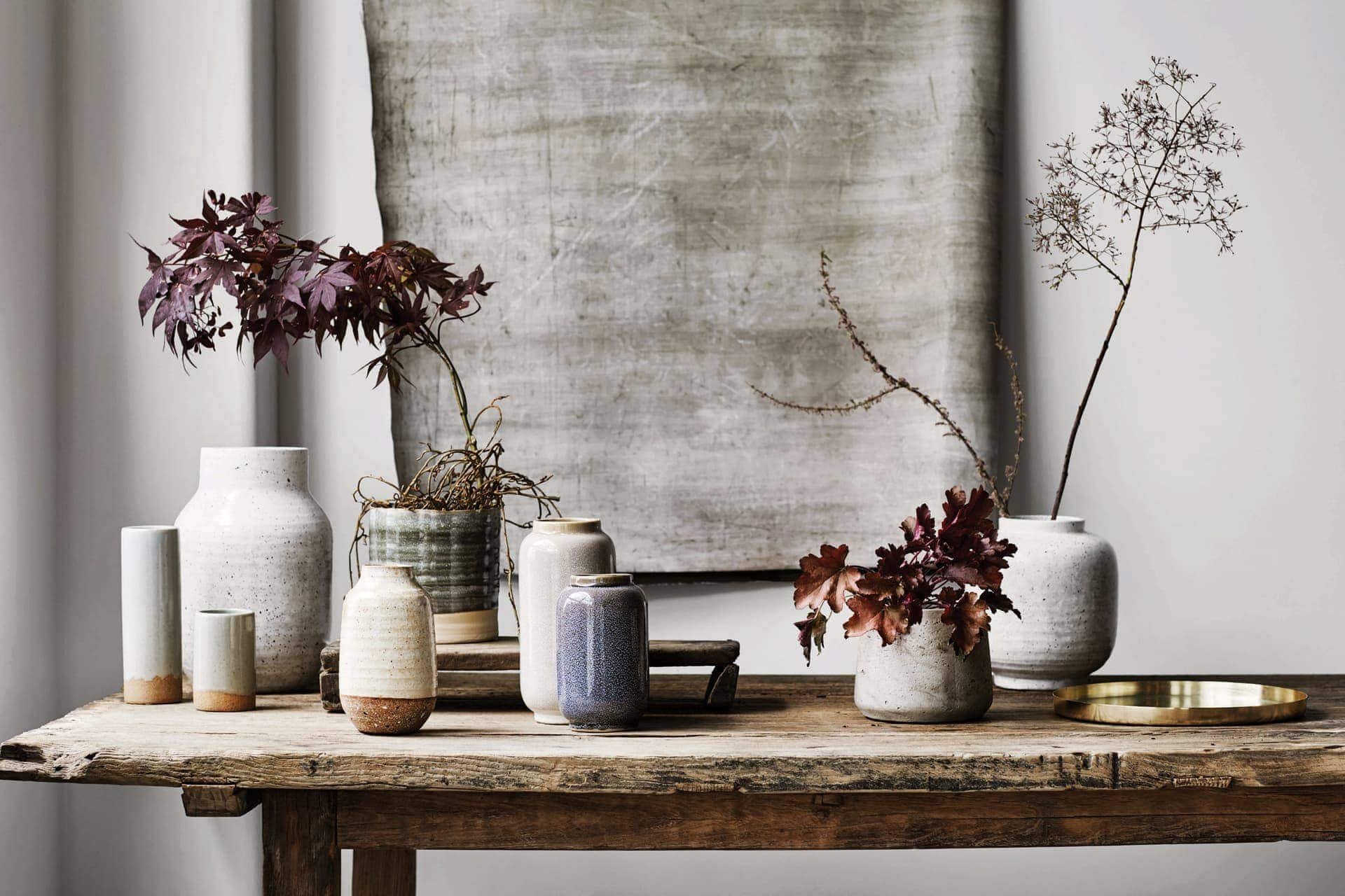 industrial dining table with handmade glazed vases from sheridan