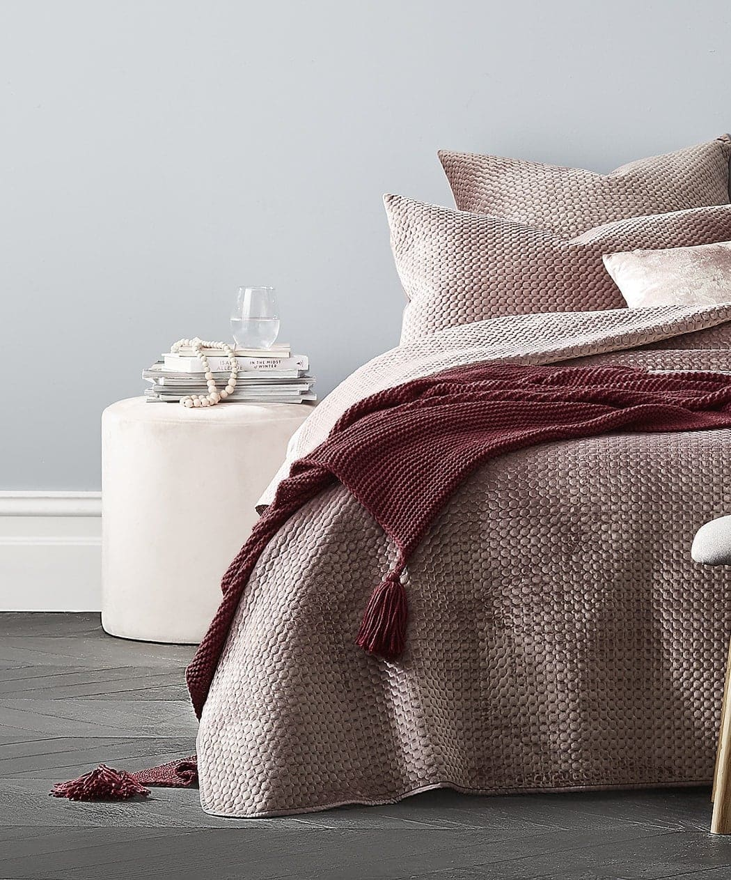 kmart pink bedspread with velvet cushions and burgundy throw