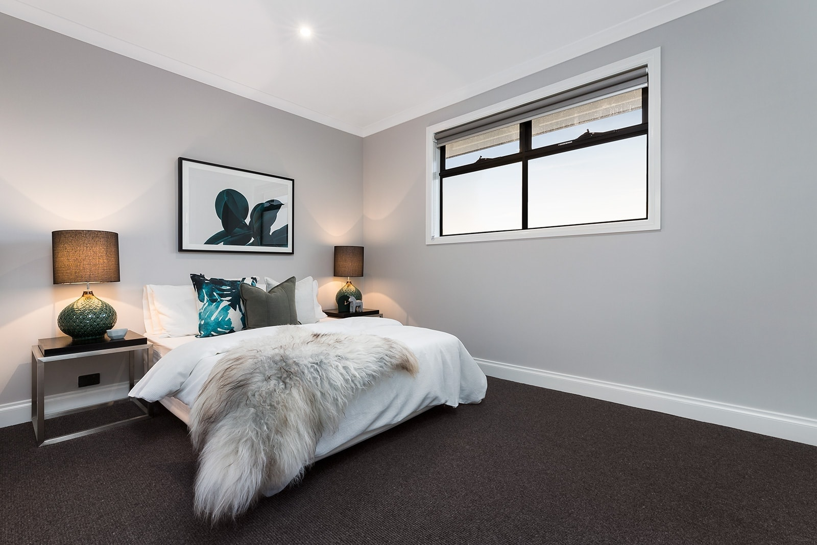 master bedroom with dark carpet and white bedding by metricon