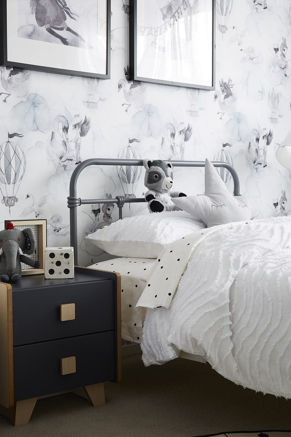 unisex kids bedroom with grey metal kids bed and mrs mighette wallpaper
