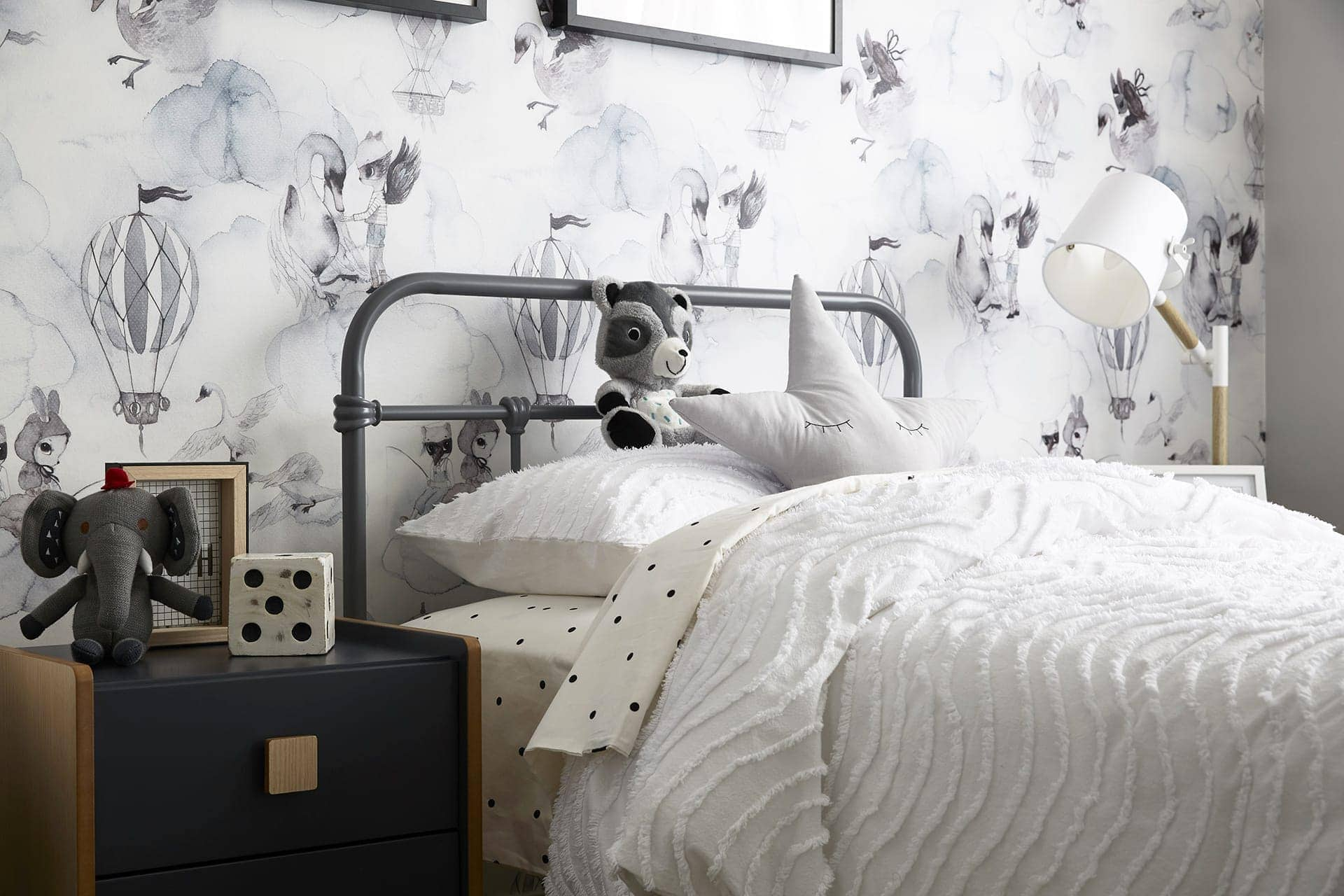 unisex kids bedroom with mrs mighetto wallpaper and grey kids metal bed