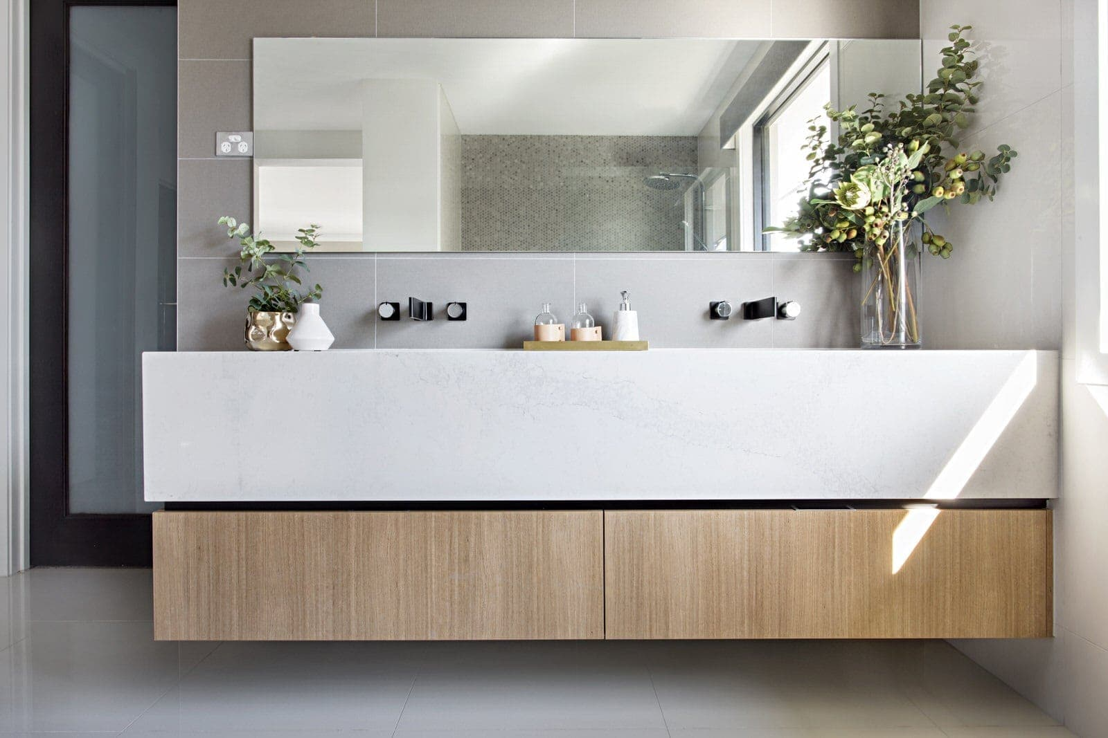 floating bathroom vanity in marble and warm timber finish in metricon display home