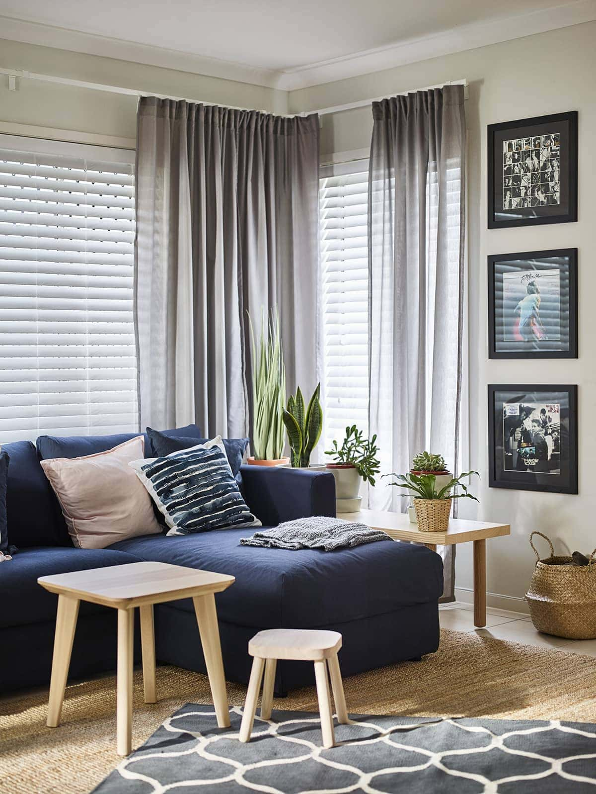 ikea navy blue sofa with chaise storage and blonde timber side tables