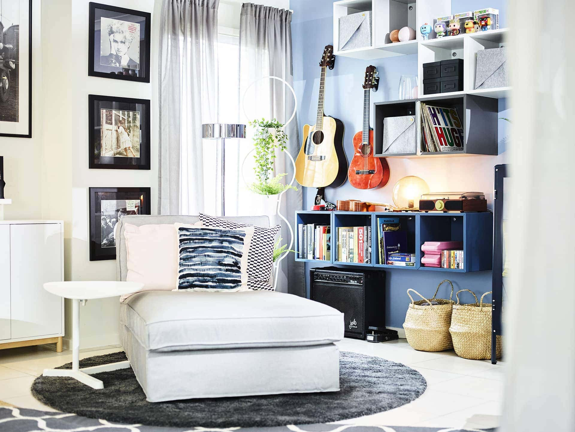 ikea white chaise armchair with white laptop table and blue shelving