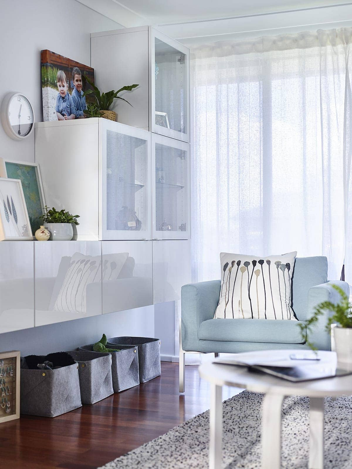 light blue ikea armchair in living room with floating ikea tv unit