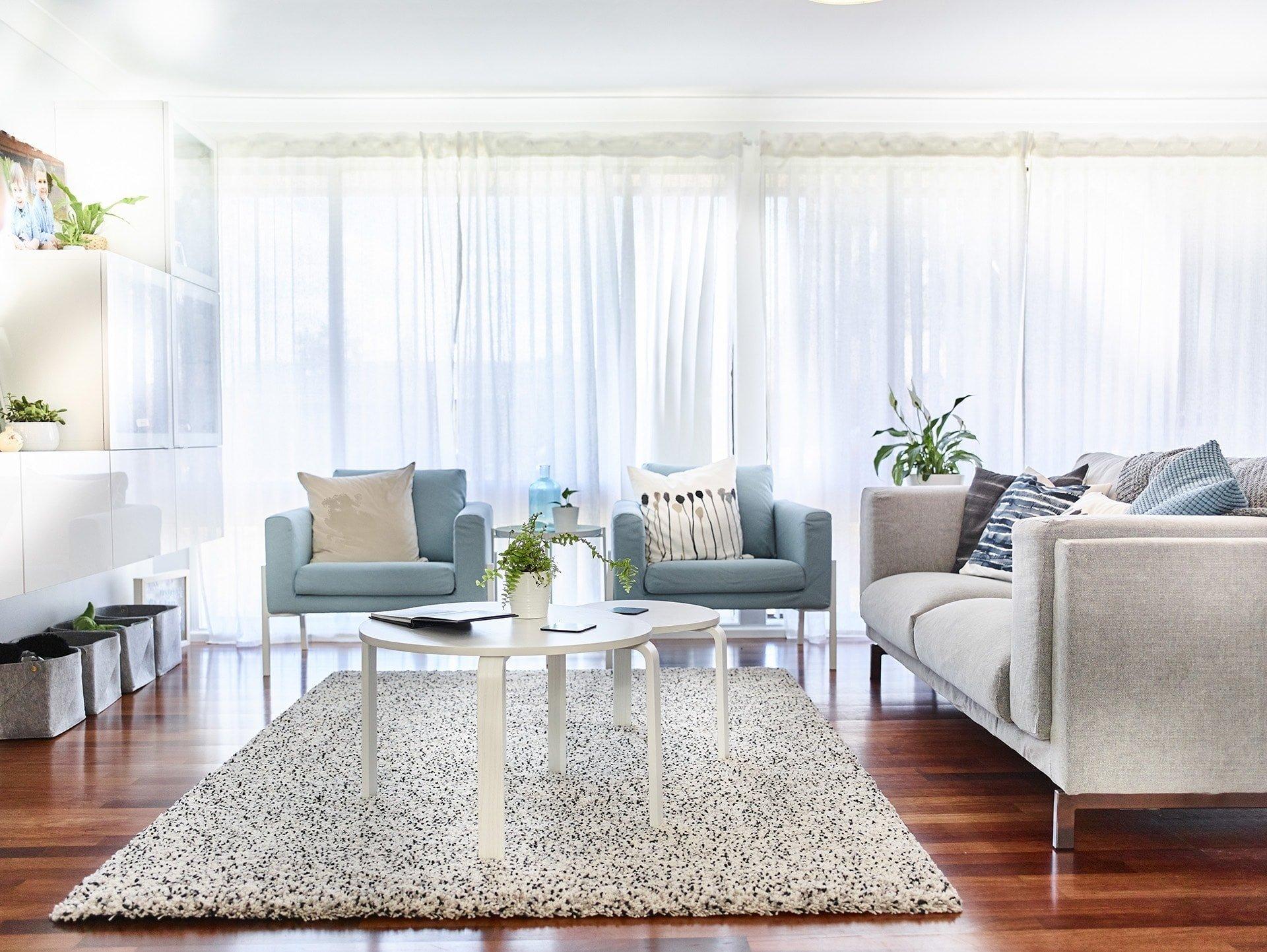 light blue ikea armchairs and grey sofa in living room with ikea shag rug