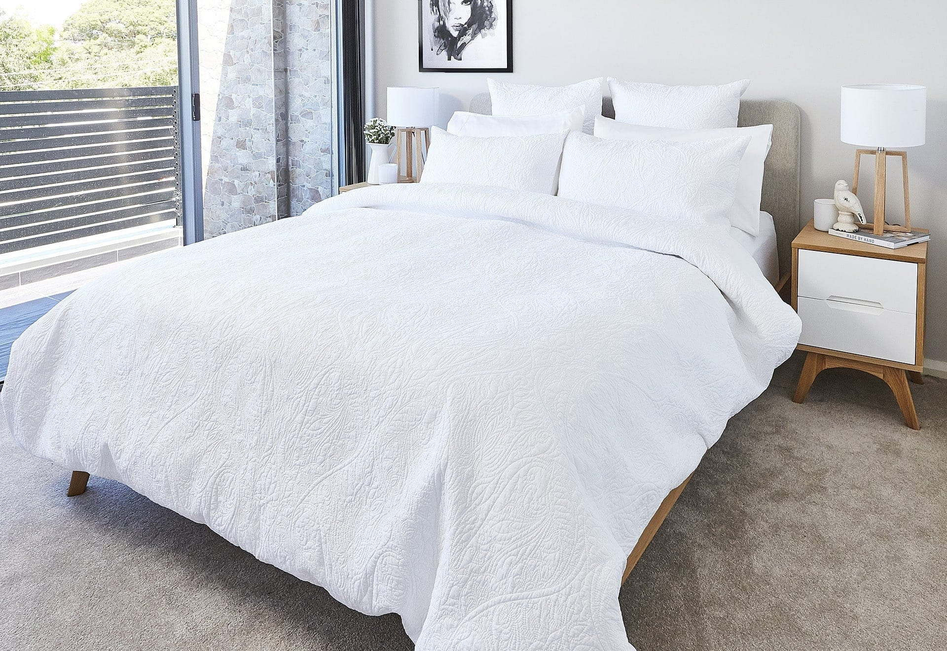 lorraine lea nook white bed linen with stitch detail in all white bedroom