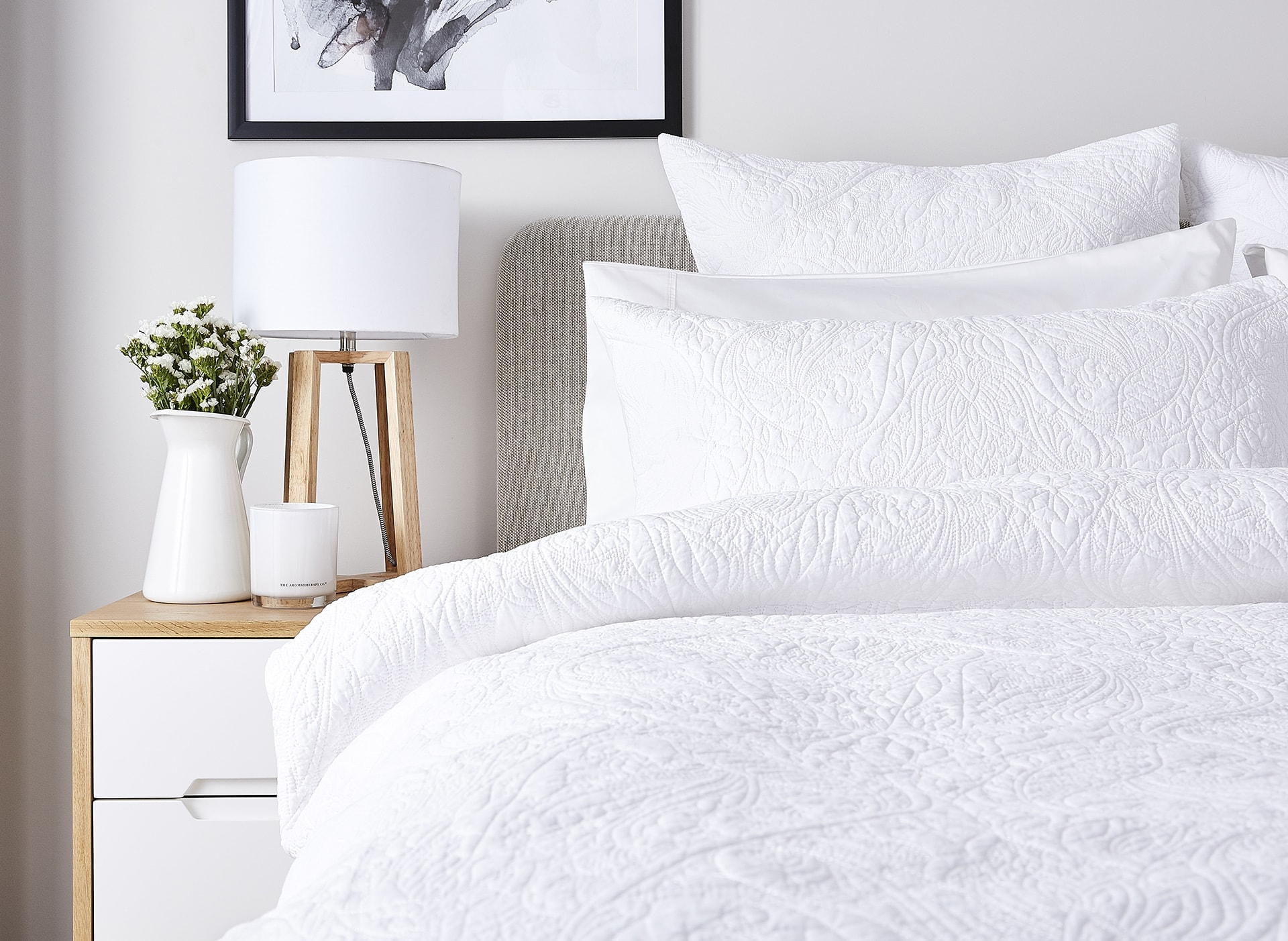 lorraine lea nook white bedding in all white room with coastal bedside table lamp