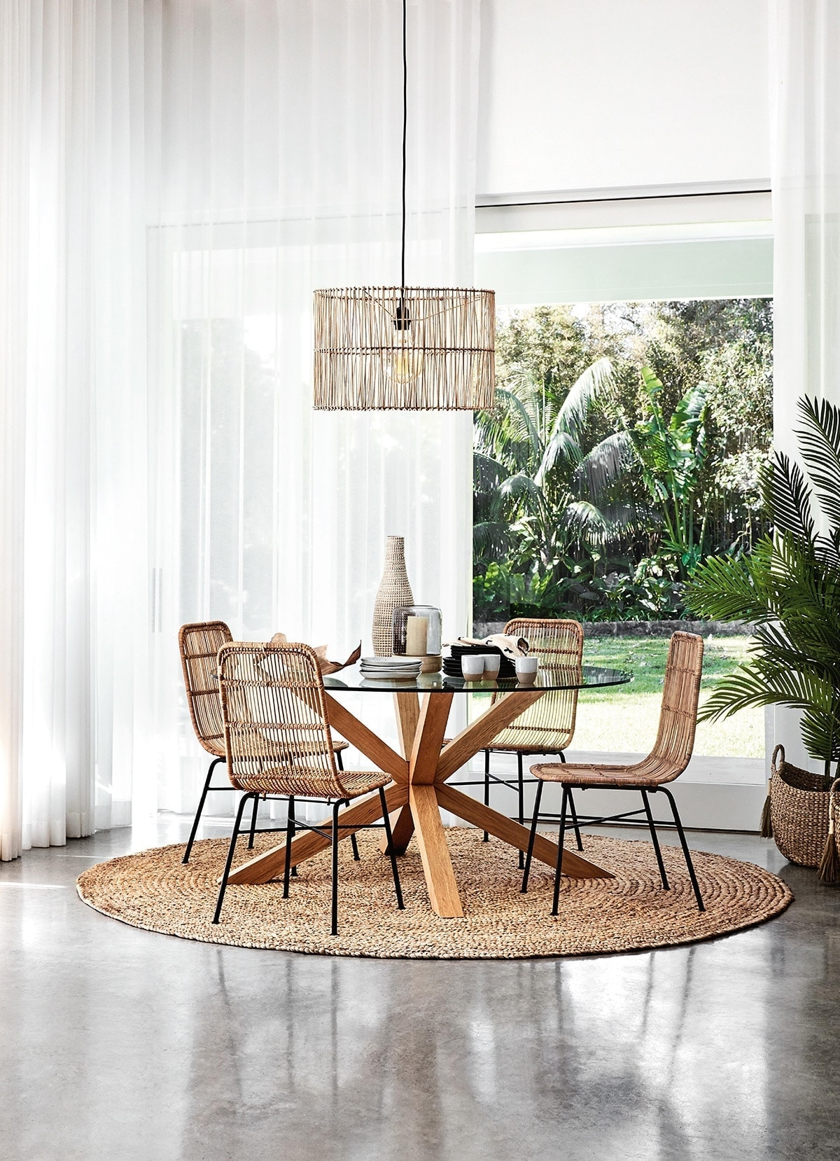 round jute rug under glass dining table from freedom with coastal dining chairs