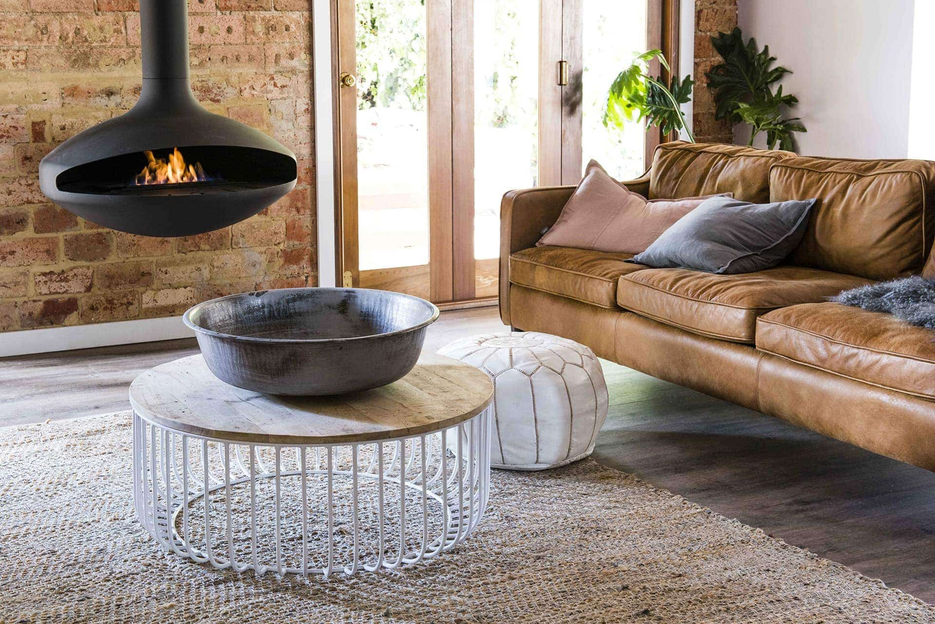 House Rules 2018 Jess and Jared living room with tan leather sofa and round coffee table