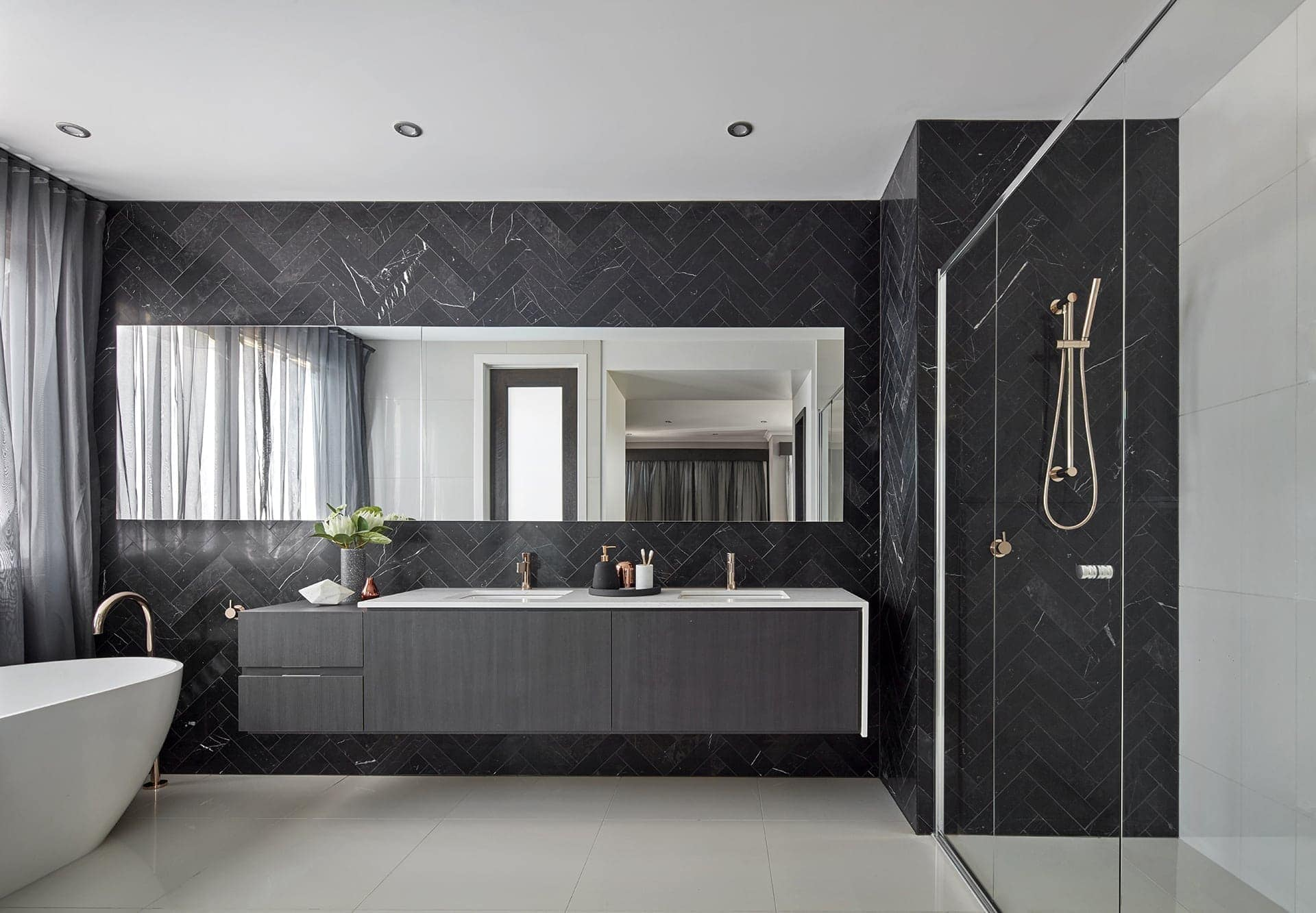 black luxe bathroom ideas marble herringbone tiles and floating bathroom vanity