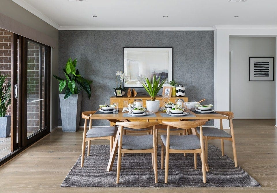 coastal dining room with blonde timber dining setting and grey feature wall