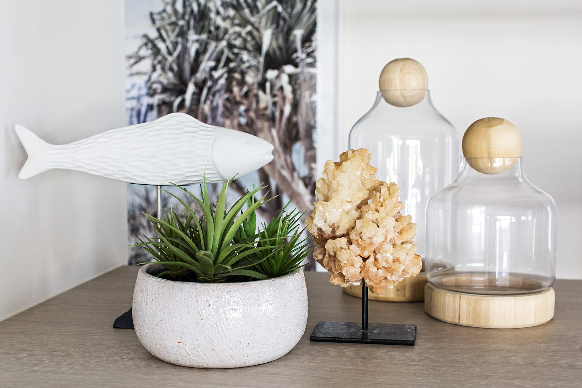 coastal styling with fake plant and glass dome and fish ornament
