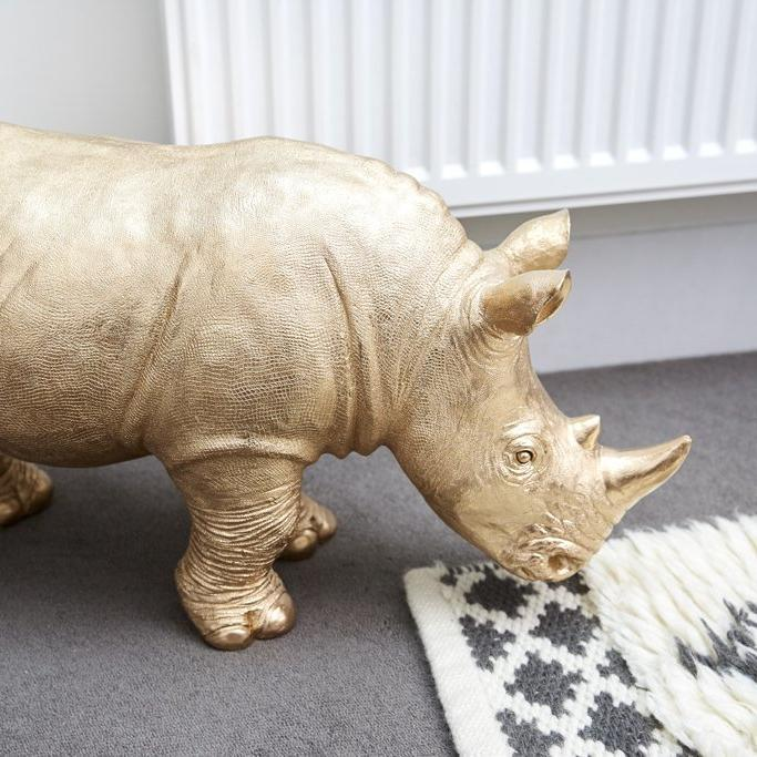 gold rhino animal statue from white moose