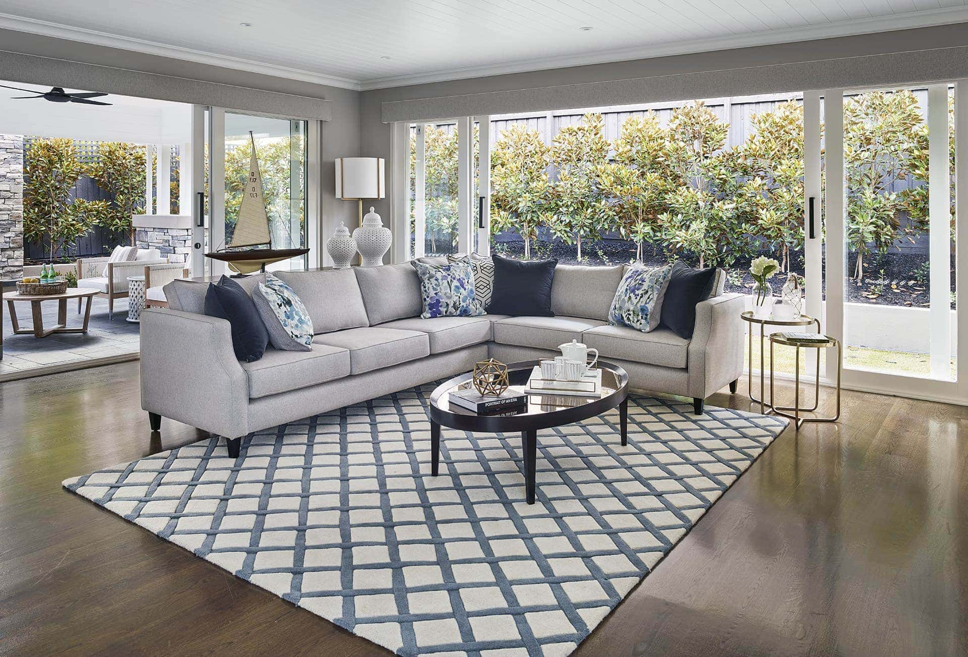 hamptons style living room with blue and white diamond hamptons rug