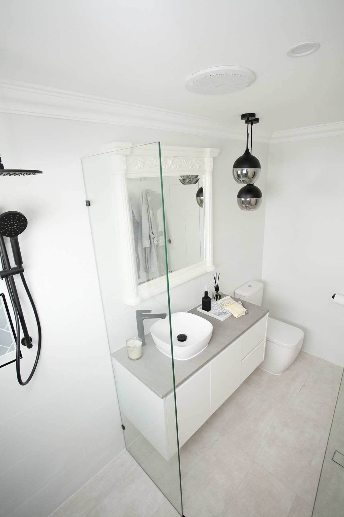 house rules 2018 mel and dave ensuite with white tiles and black tapware