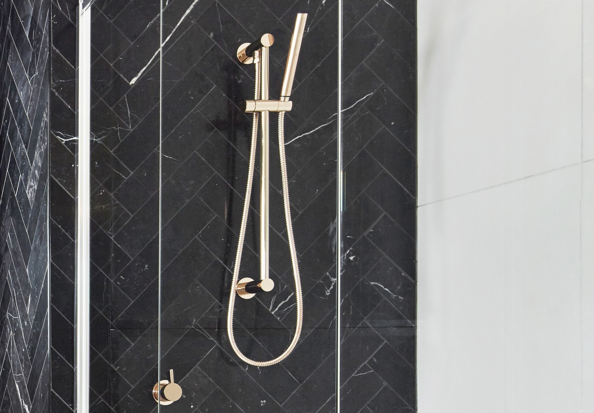 luxe bathroom ideas black tile bathroom with gold accents