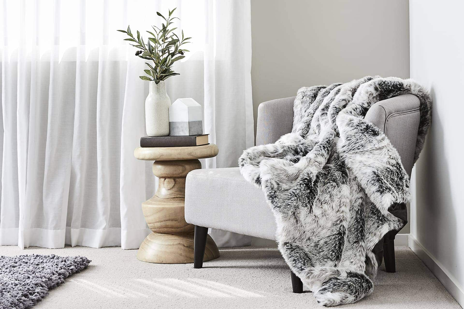 melbourne interior designers tlc interiors grey armchair with faux fur throw