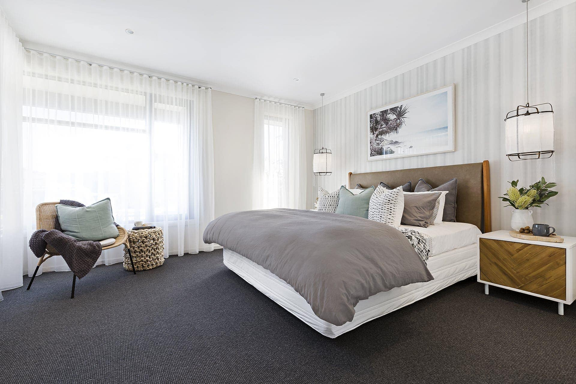 modern coastal bedroom with dark carpet and sheer curtains
