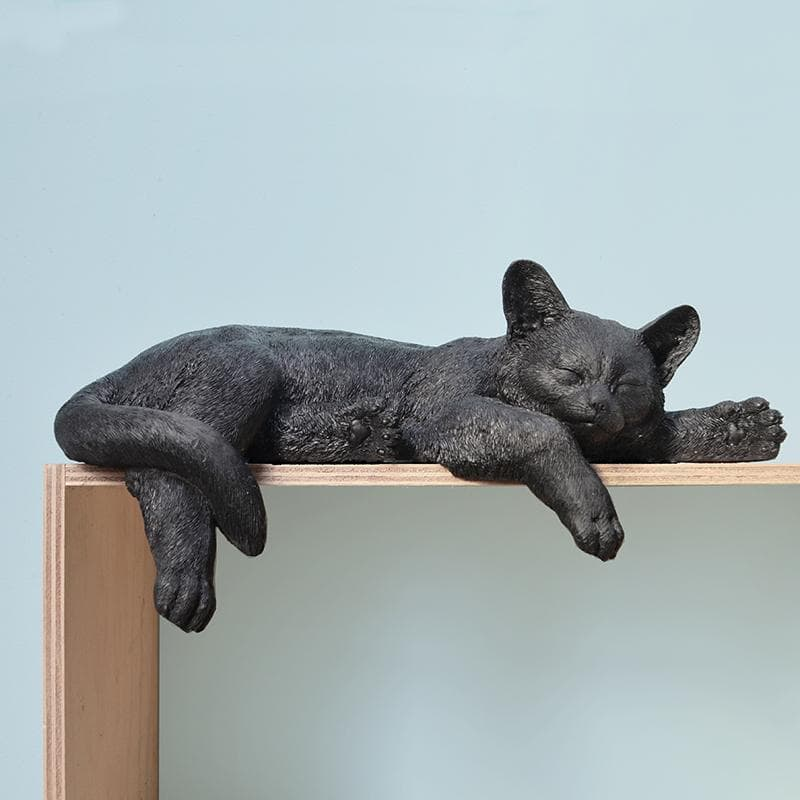 toby the sleeping cat statue in black from white moose