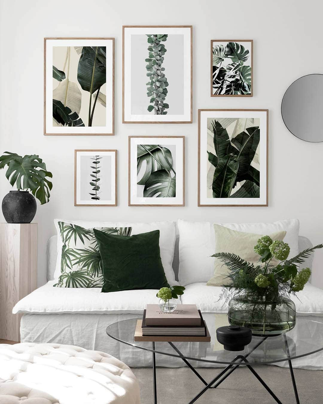 white living room with green accents botanical interior design desenio art