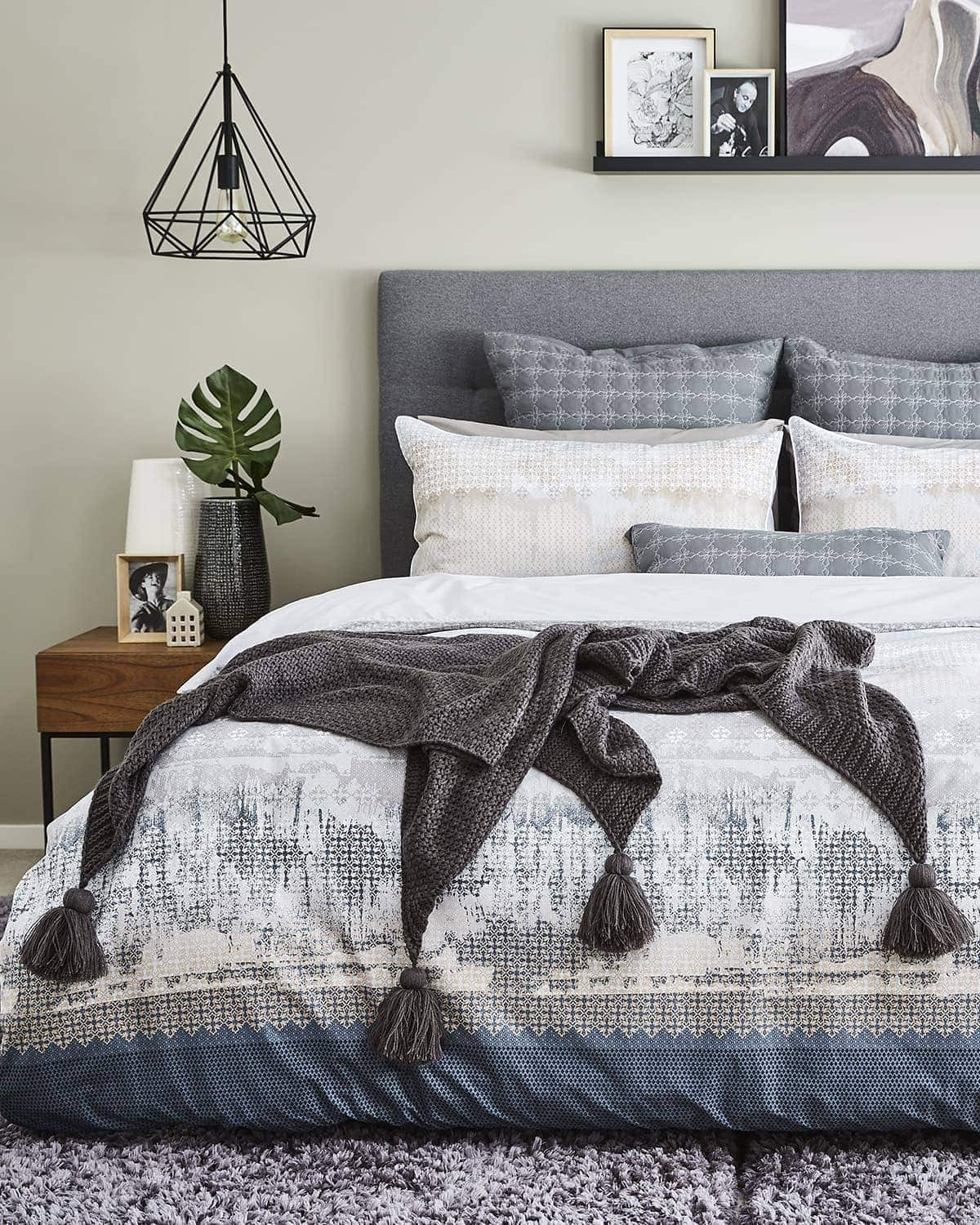 winter bedroom styling with lorraine lea conor quilt and black mesh pendant lights over bedside