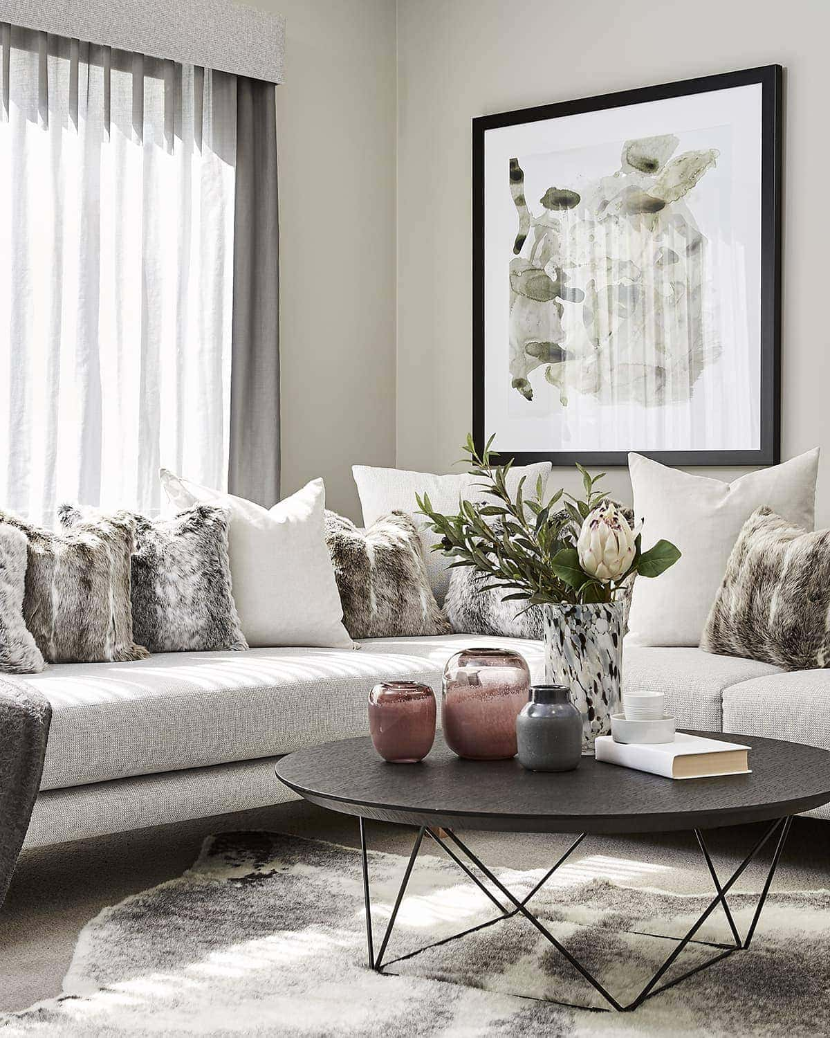 winter living room decorating with faux fur rug and round black coffee table