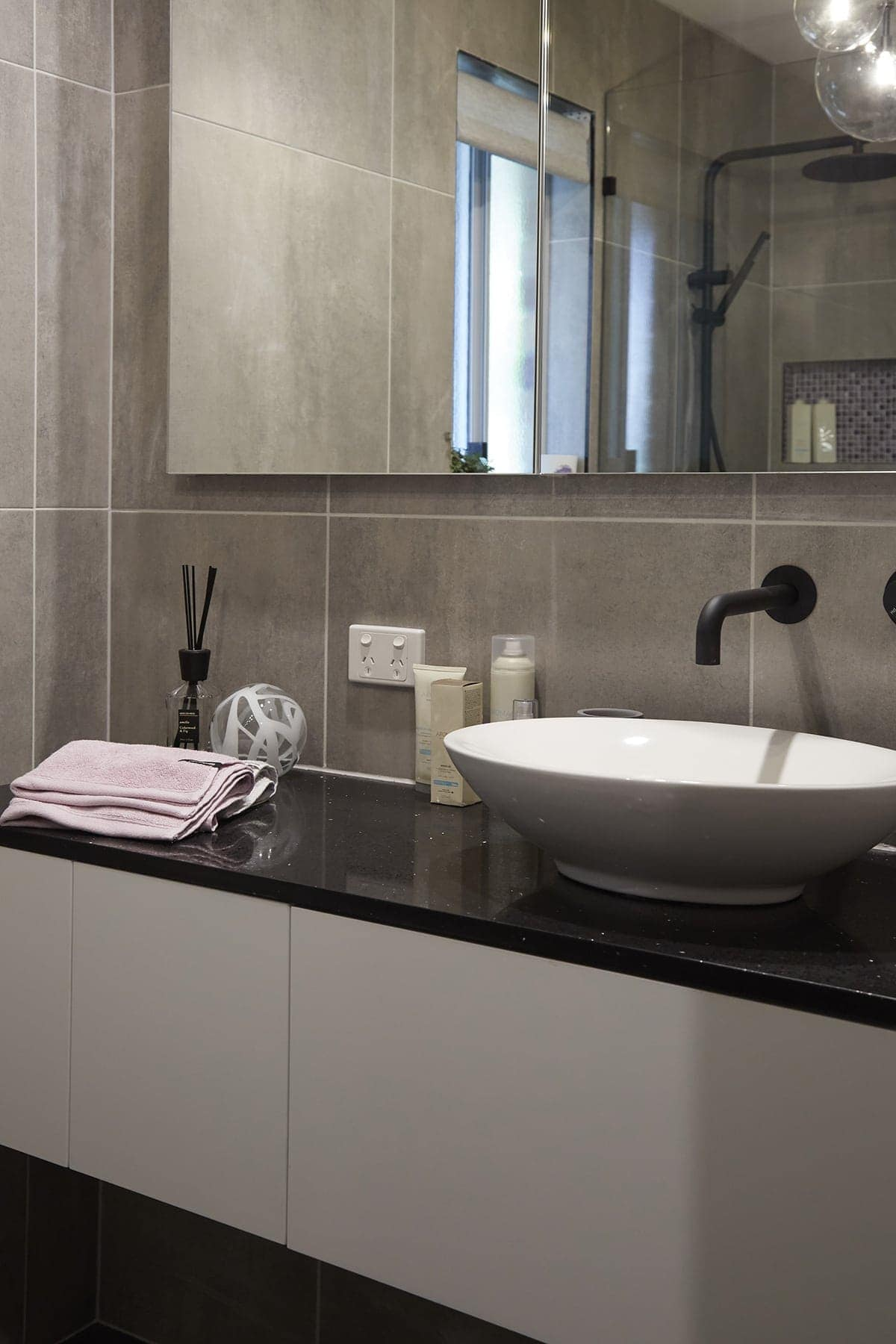 house rules 2018 kim and michelle ensuite with large grey tiles and black vanity top