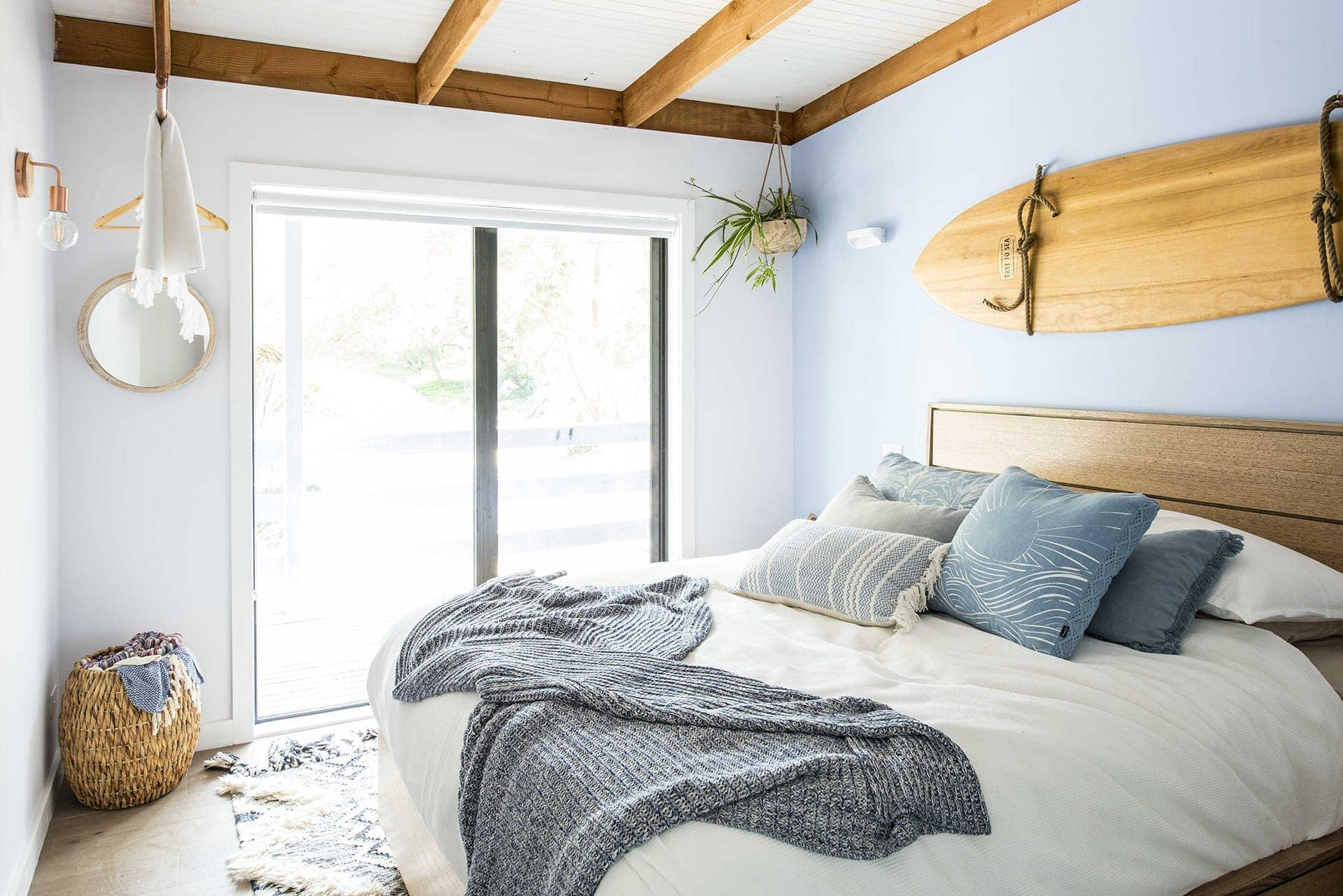 house rules 2018 leigh and kristie bedroom with surfboard above bed