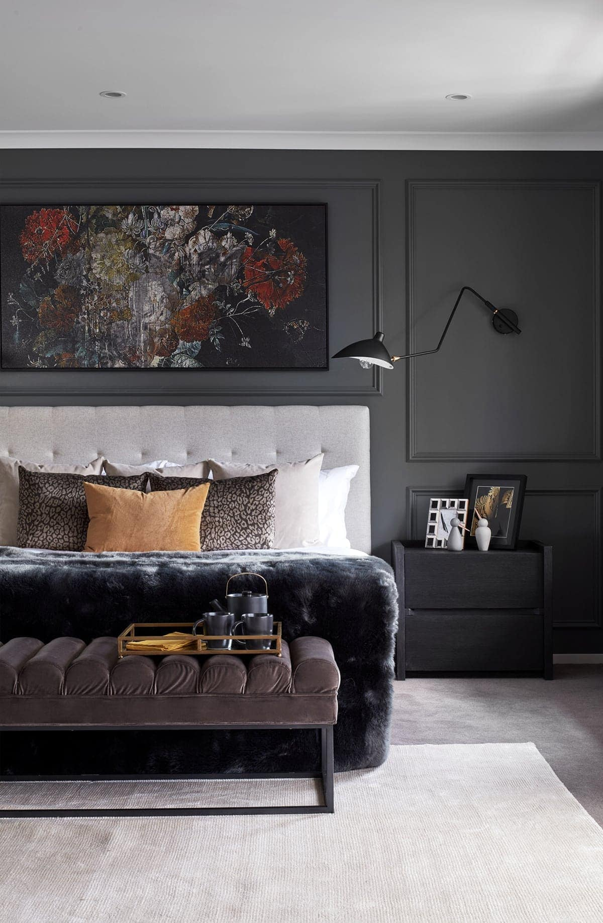 luxe master bedroom with grey feature wall and floral wall art