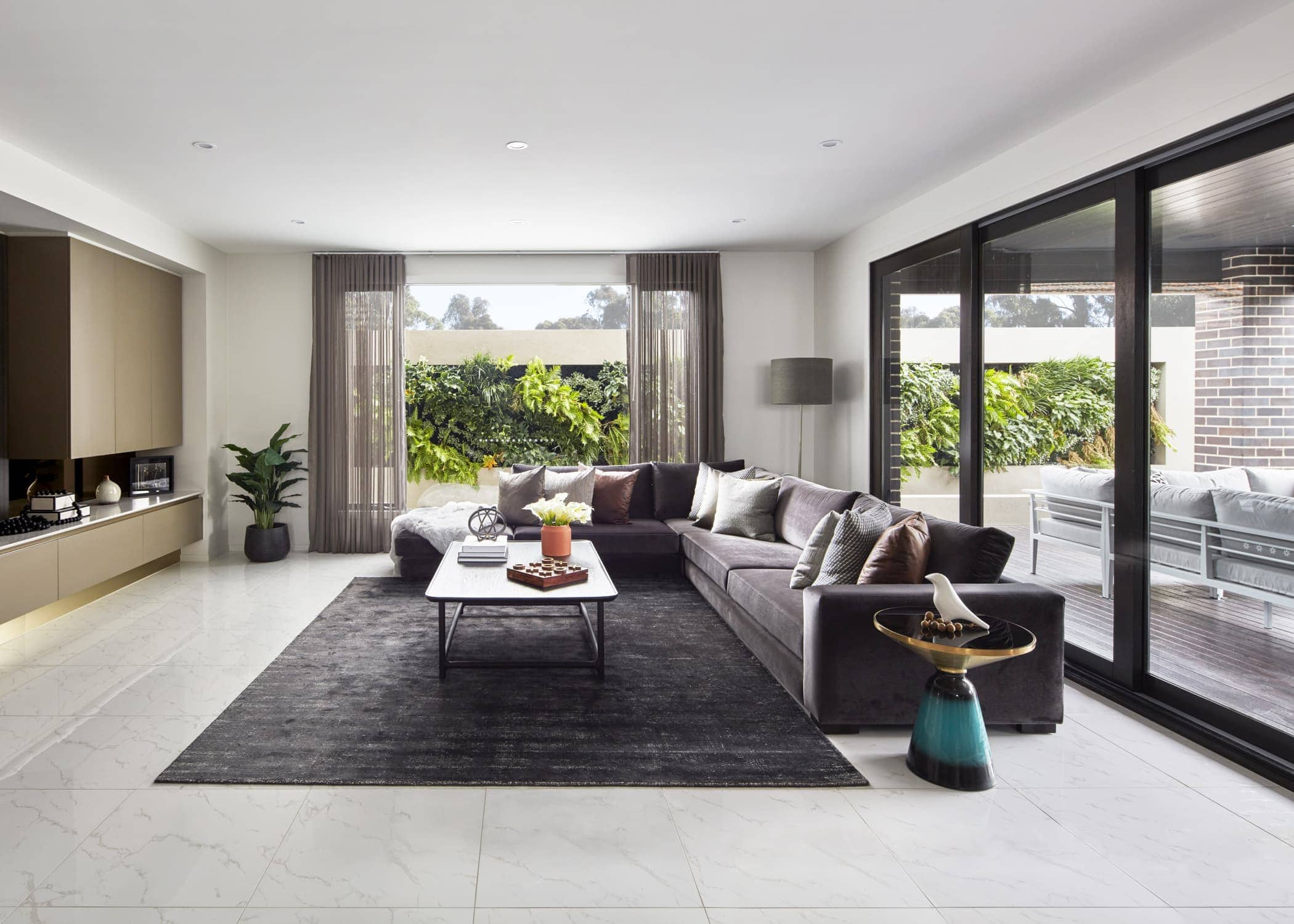 masculine living room in metricon hampshire display