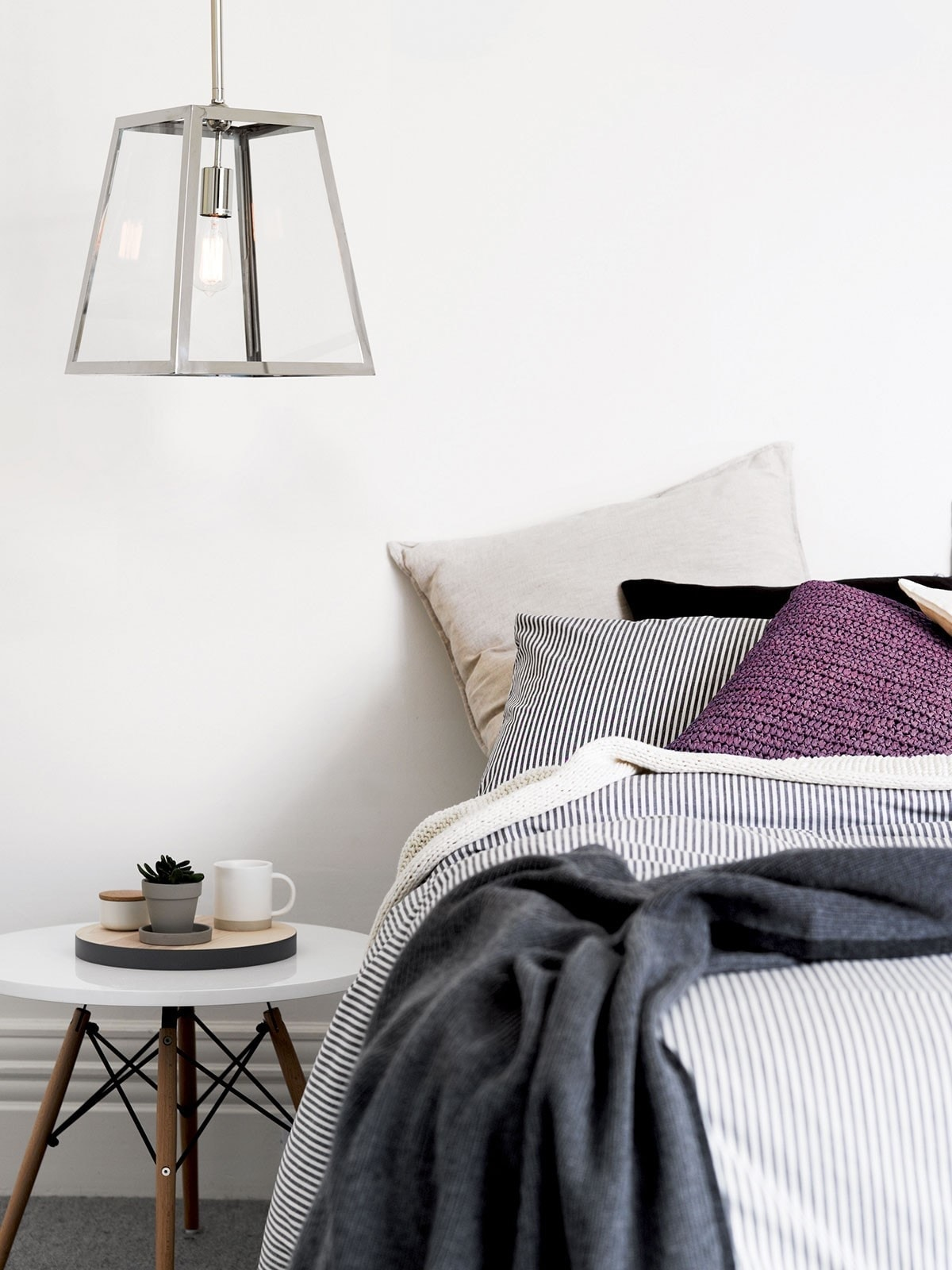 beacon lighting master bedroom pendants in room with ensemble bed
