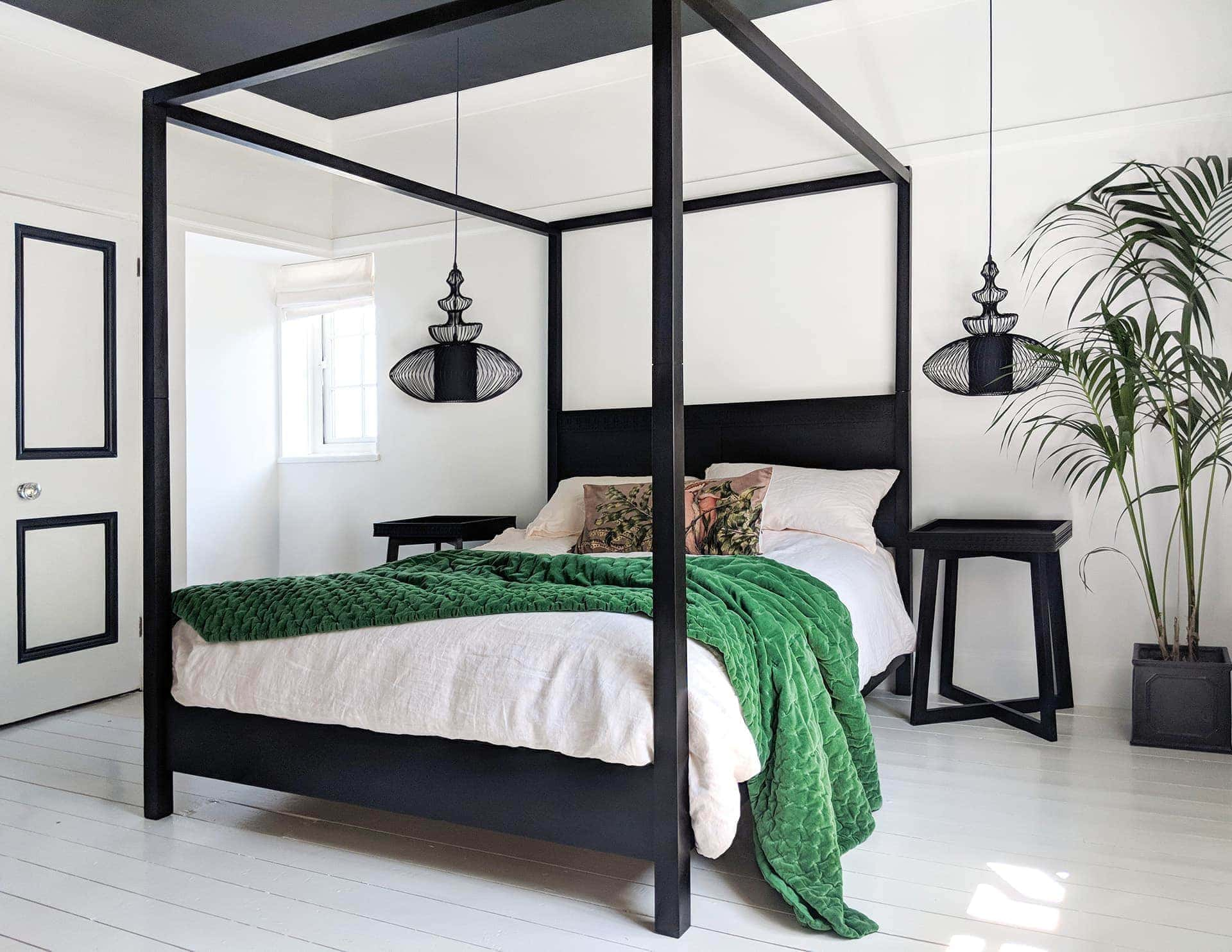 black-tribal-pendant-lights-hanging-above-bedside-tables-in-master-bedroom