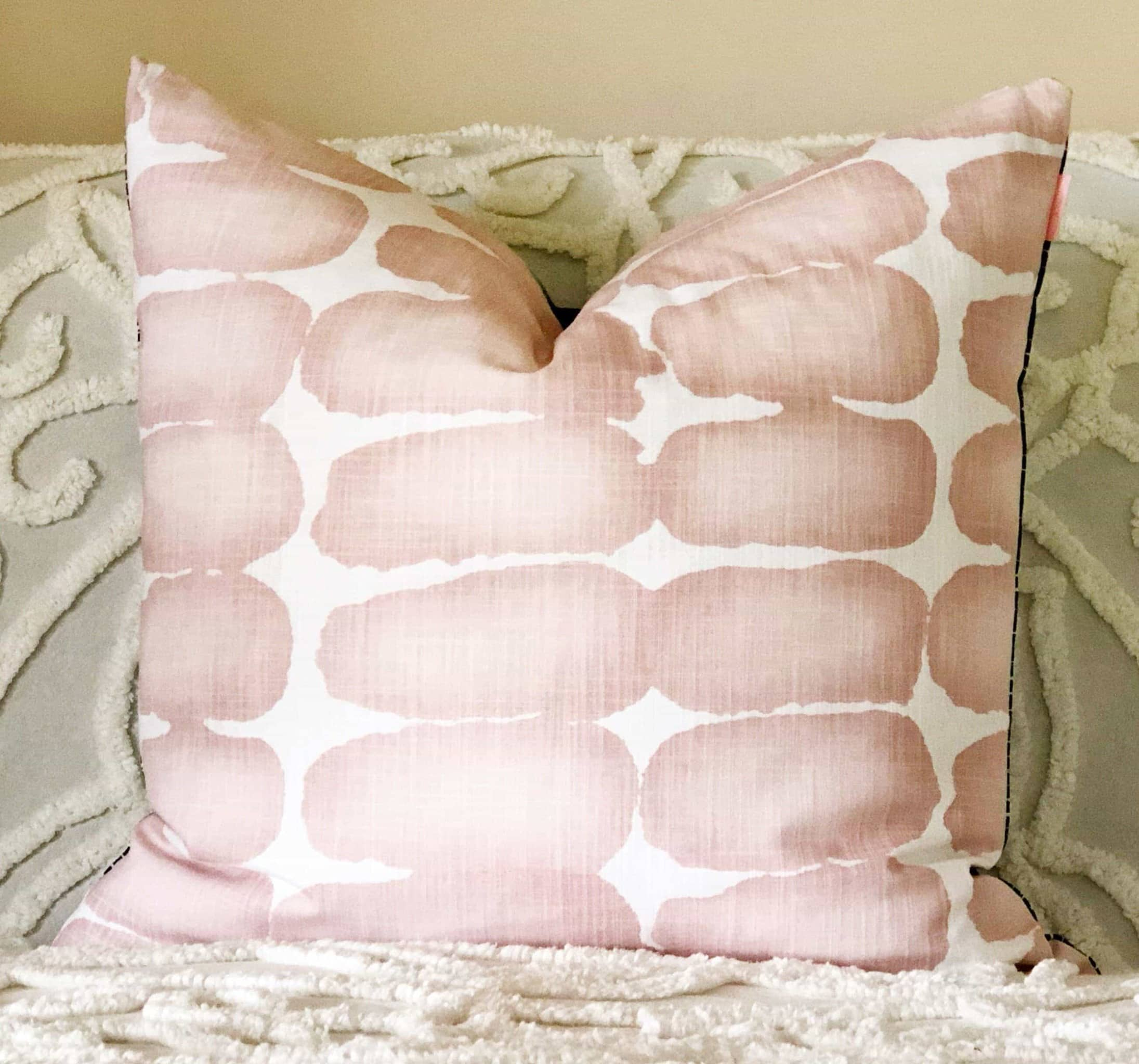 blush and white cushion by tribe and temple