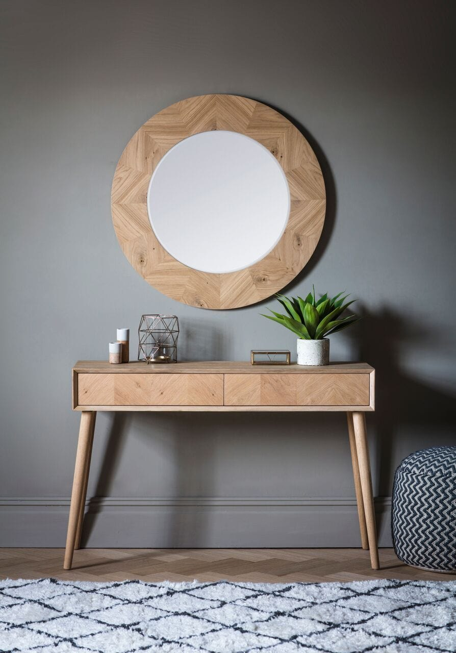 millard large round timber mirror against charcoal grey wall