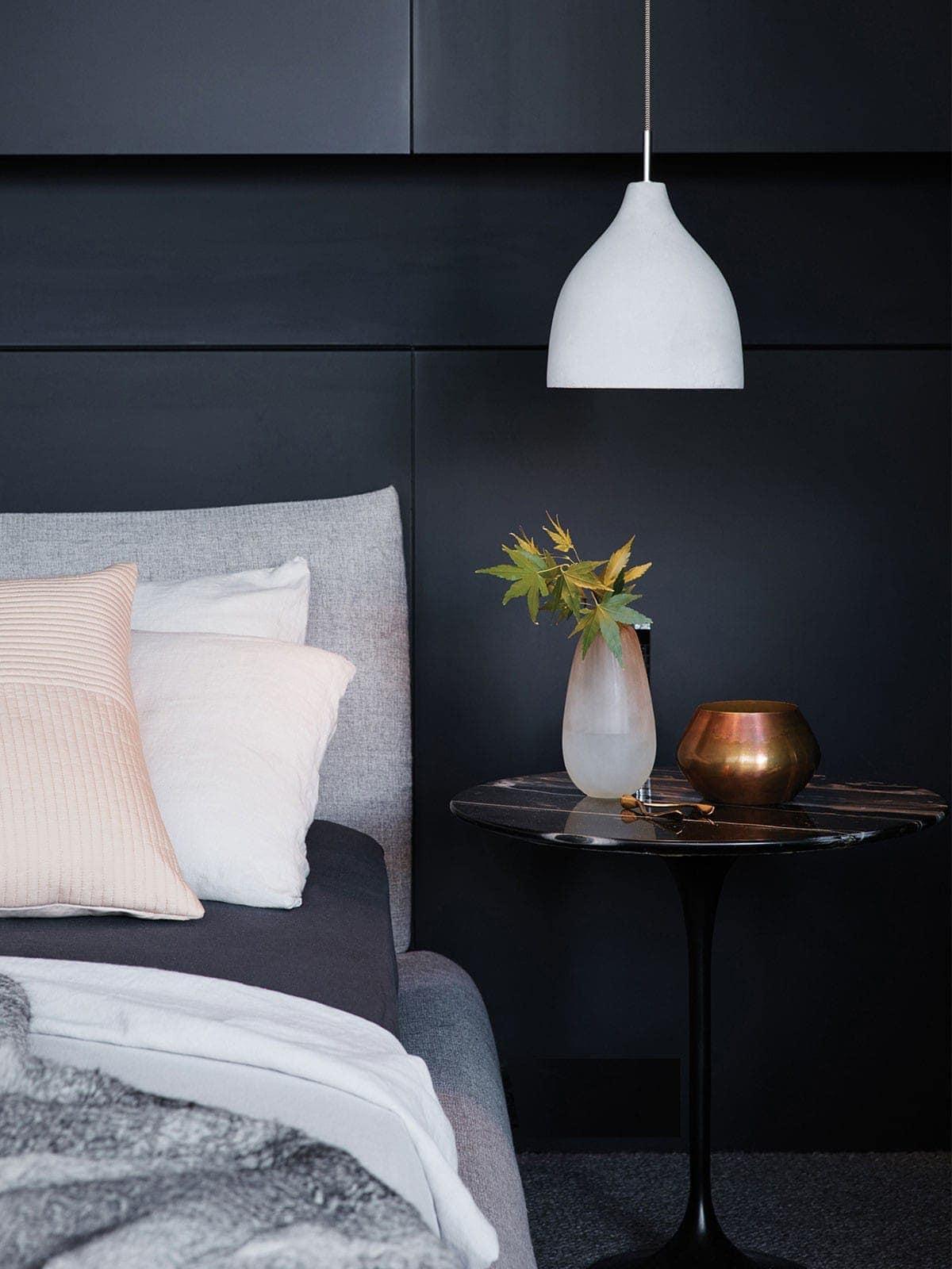 round concrete pendant in master bedroom by beacon lighting