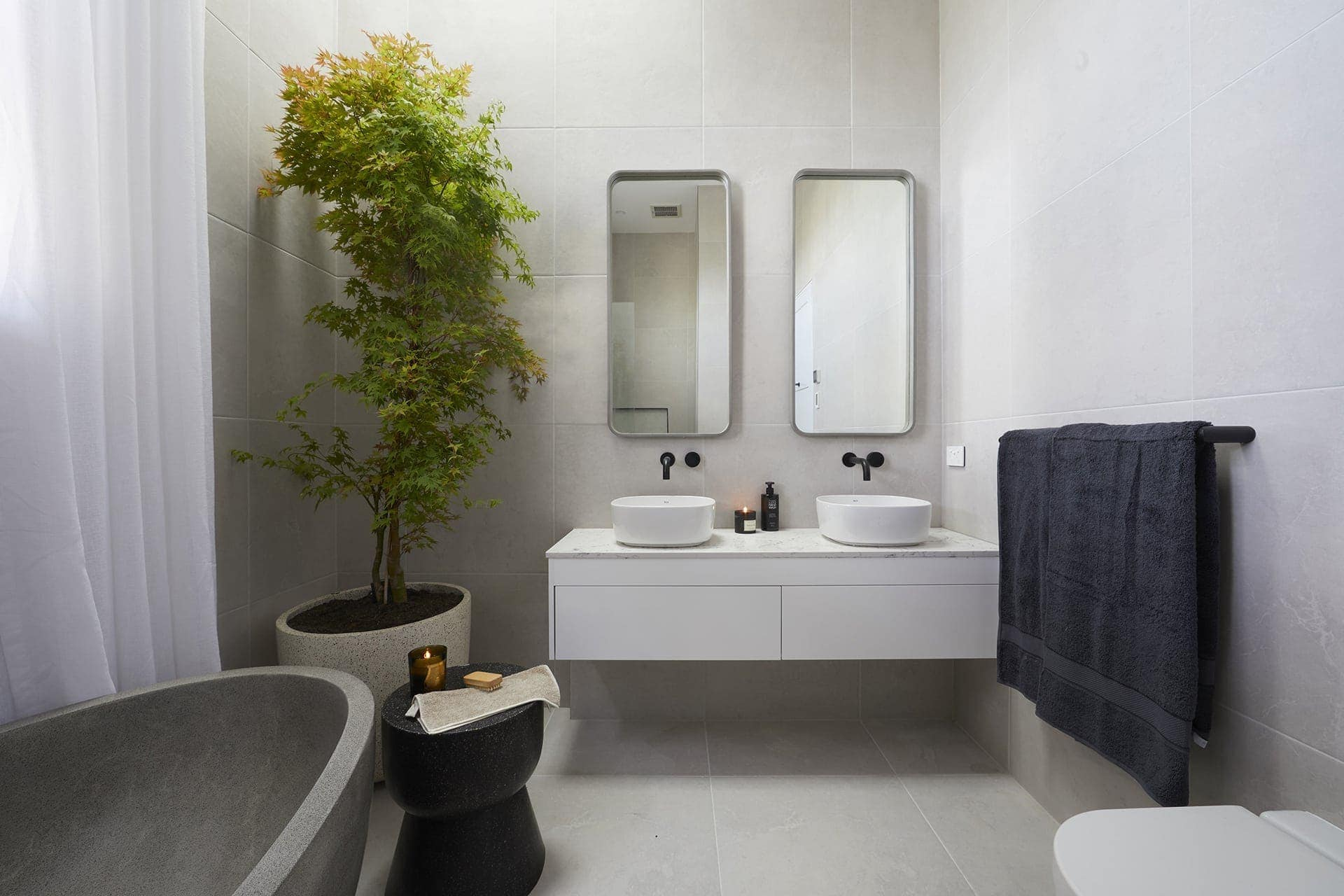the block 2018 bathroom reveals norm and jess bathroom with large plant in corner