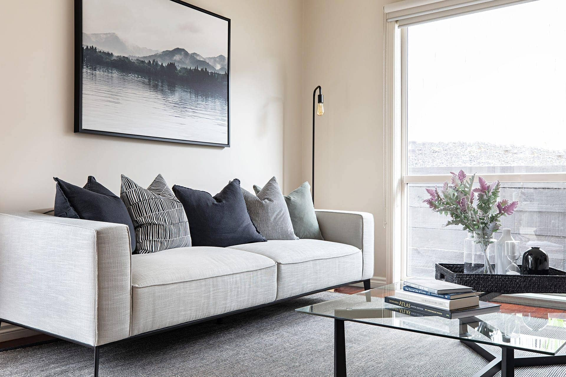 tlc interiors melbourne interior designer scandinavian living room with grey sofa and green cushions