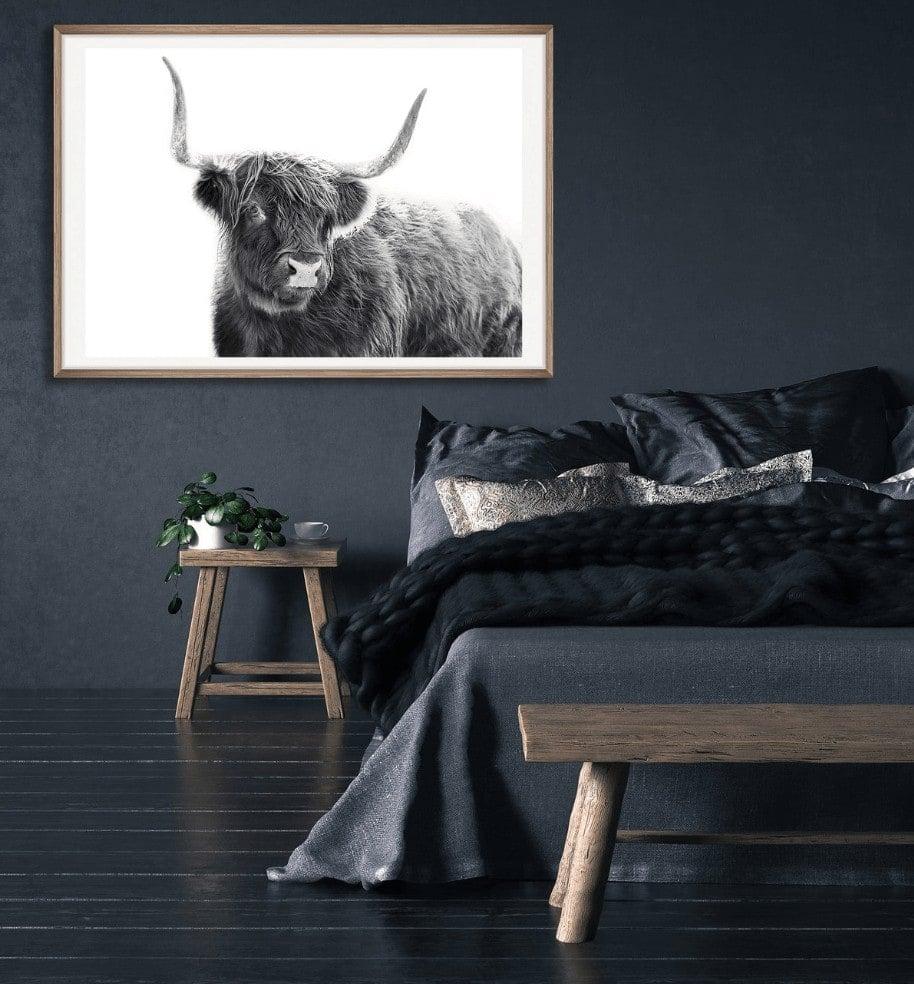 bull artwork on black wall by the horns