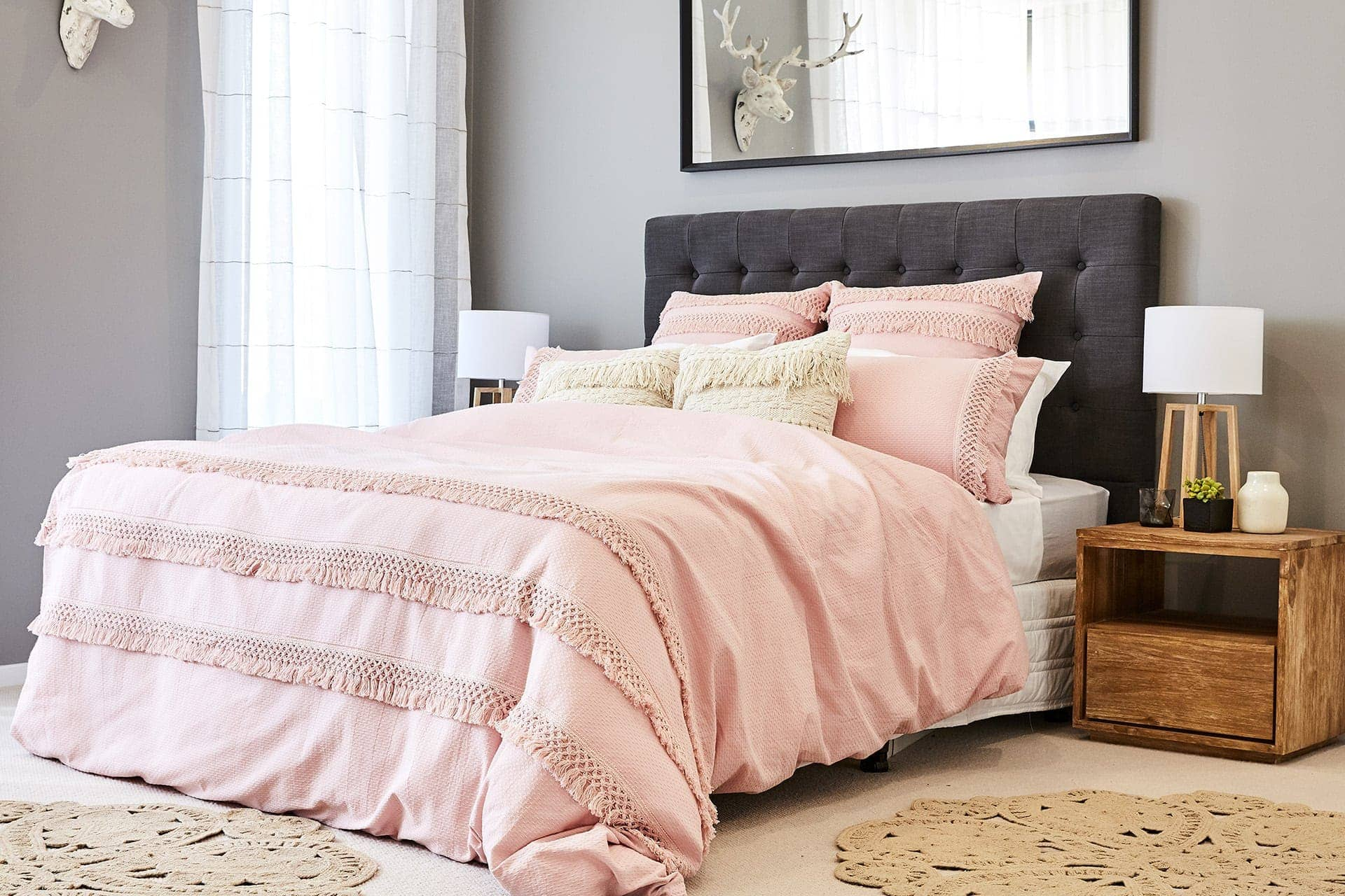 colourful bohemian interior design idea pink bedding on grey bedhead