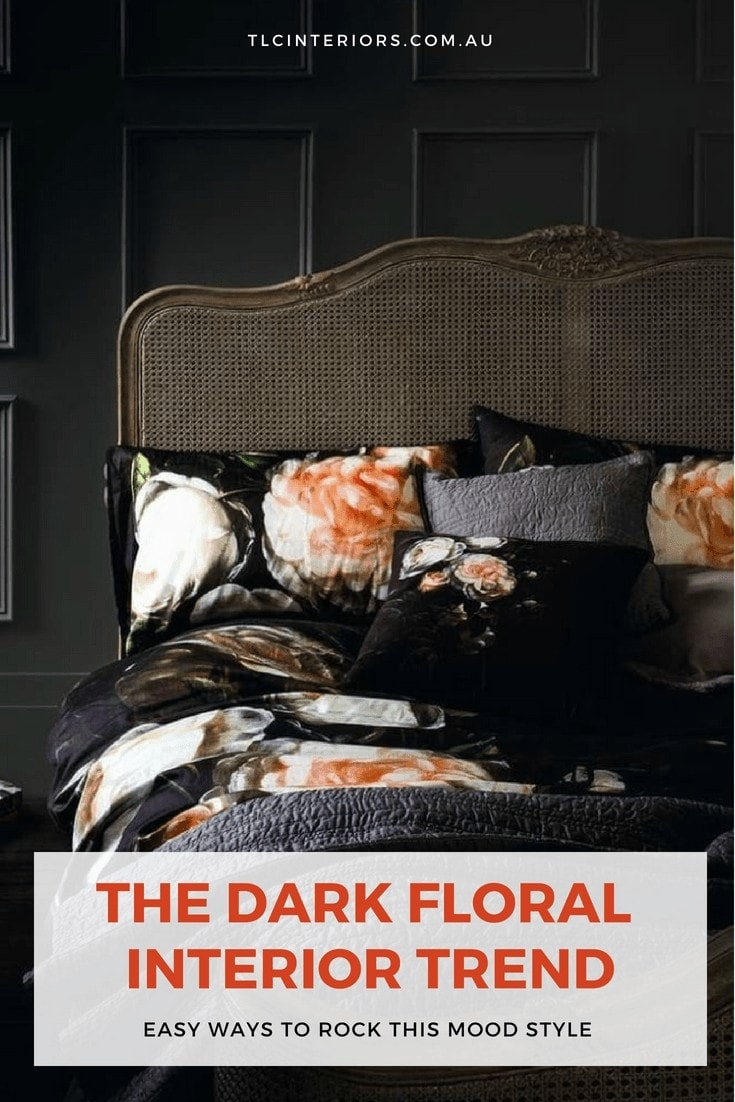 dark floral bedding set in bedroom with black walls