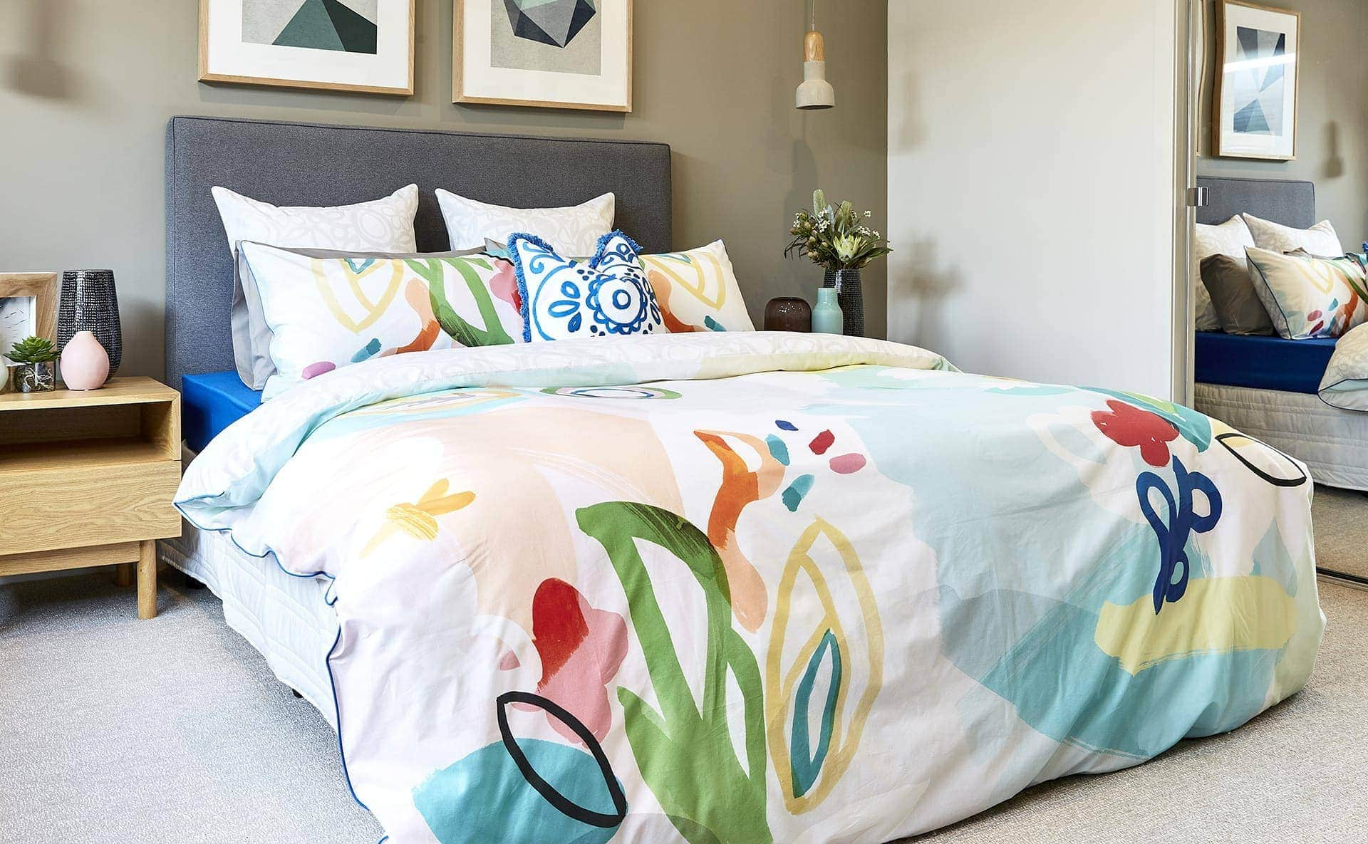 lorraine lea colourful bedding set against charcoal grey headboard spring decorating ideas tlc interiors